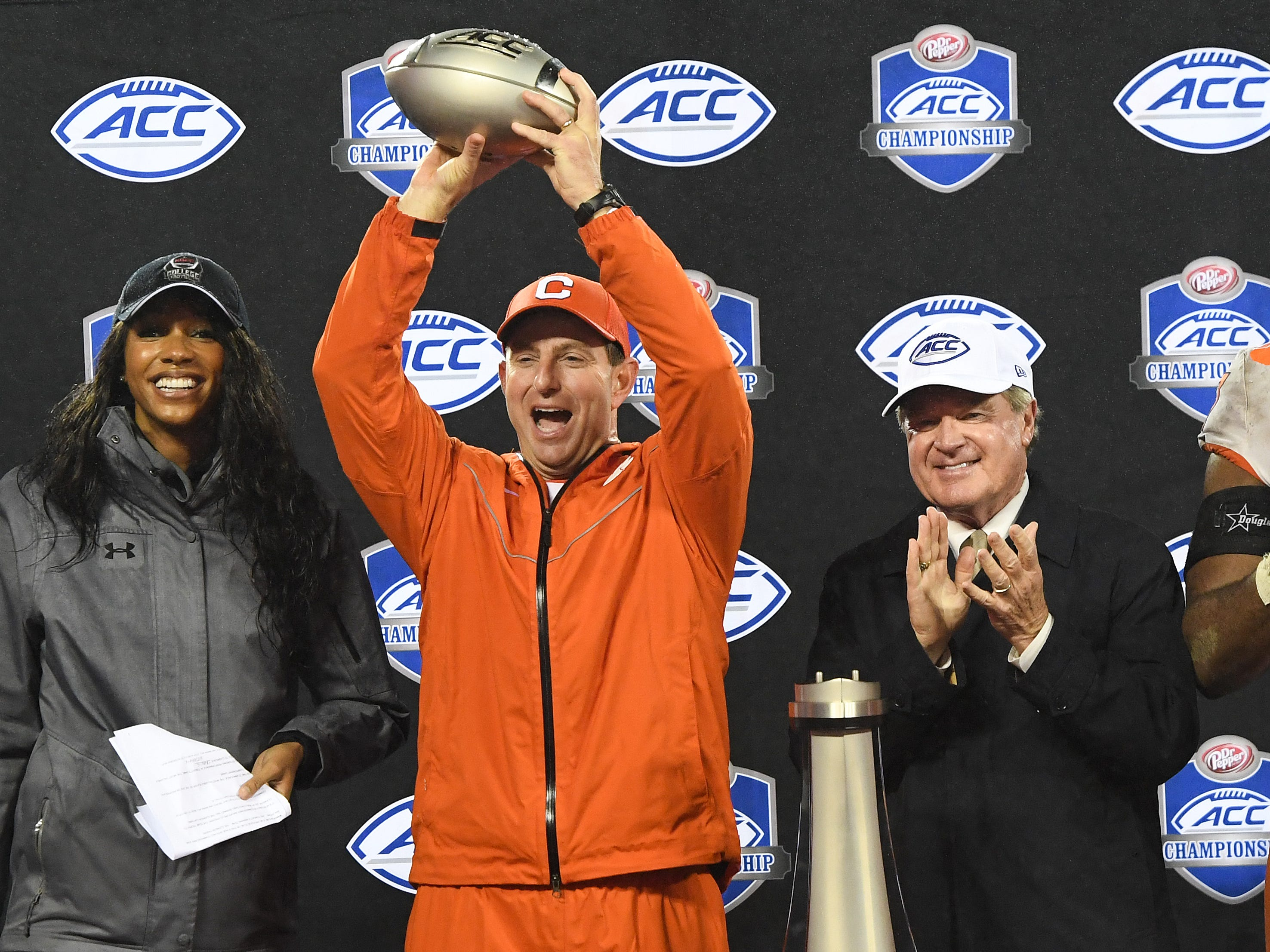 Clemson head coach Dabo Swinney holds the Dr. Pepper ACC Championship trophy after the Tigers 42-10 win over Pittsburgh at Bank of America Stadium in Charlotte, N.C. Saturday, December 1, 2018.