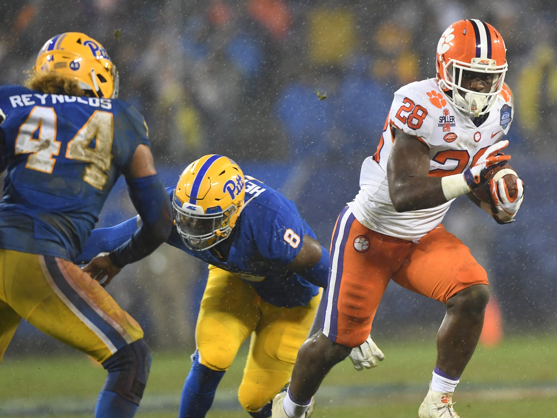 Clemson running back Tavien Feaster (28) carries against Pittsburgh during the 2nd quarter of the Dr. Pepper ACC Championship at Bank of America Stadium in Charlotte, N.C. Saturday, December 1, 2018.