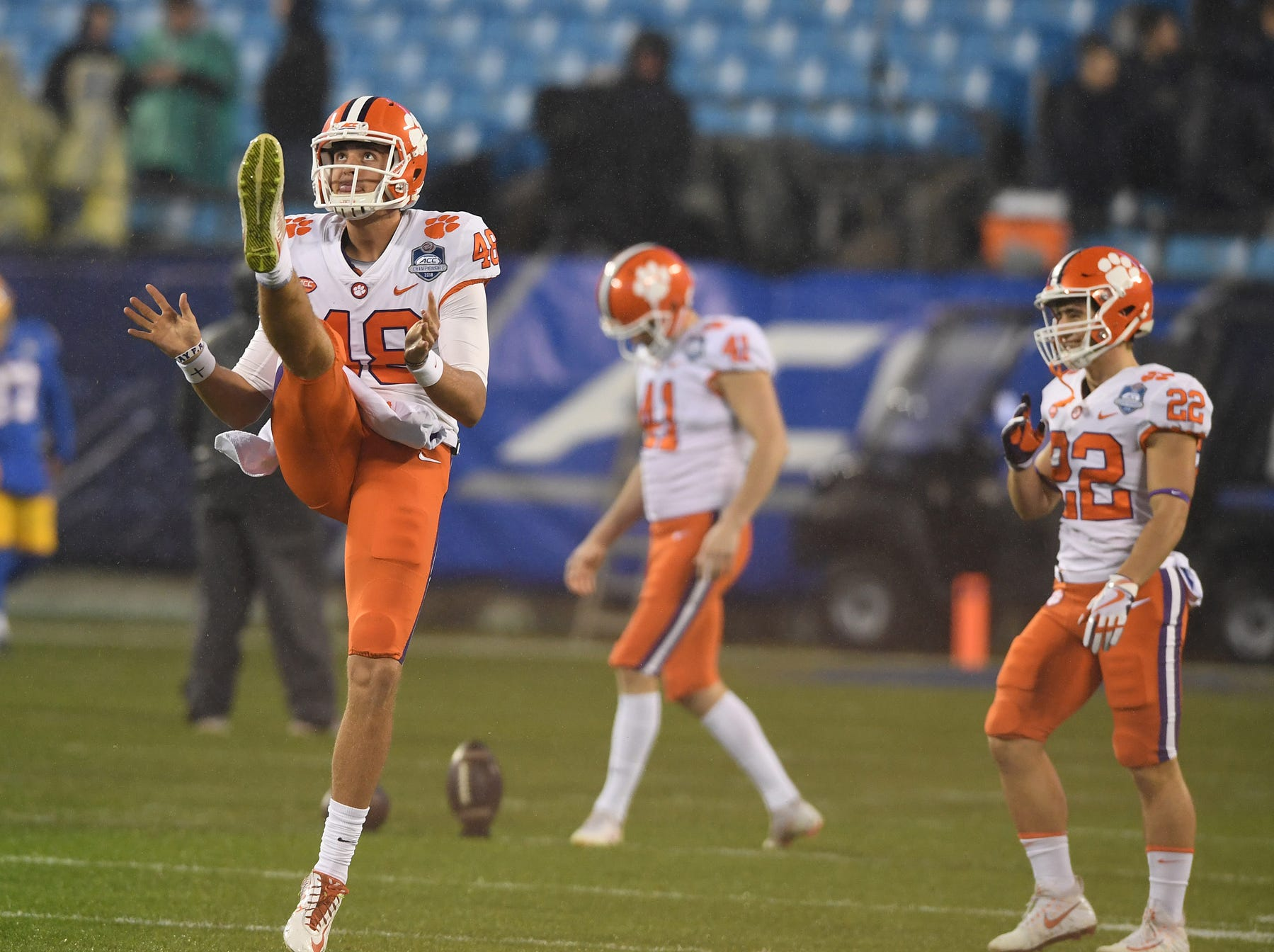 Clemson punter Will Spiers (48) kicks during pregame of the Dr. Pepper ACC Championship at Bank of America Stadium in Charlotte, N.C. Saturday, December 1, 2018.