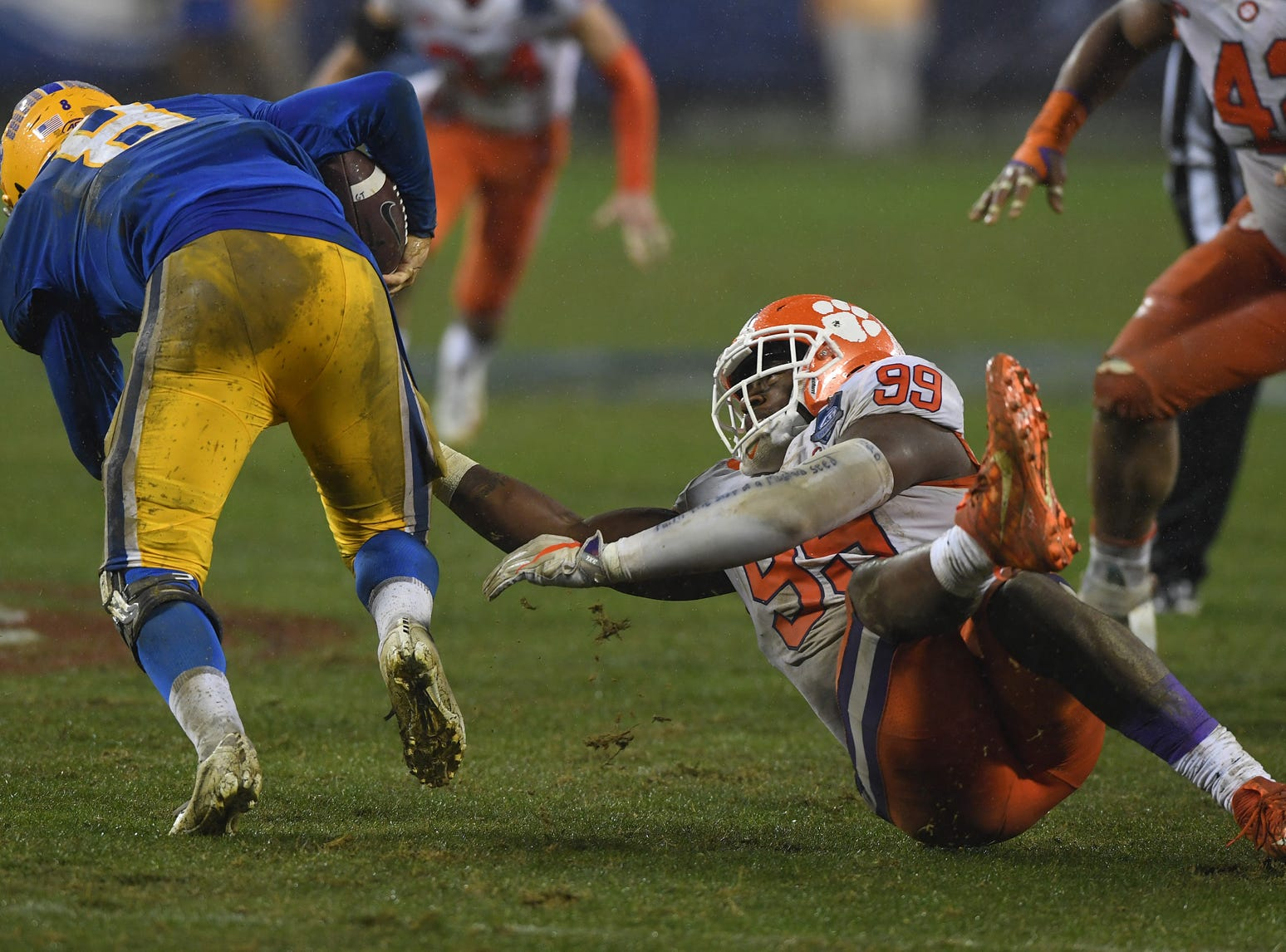 Clemson defensive lineman Clelin Ferrell (99) brings down Pittsburgh quarterback Kenny Pickett (8) during the 2nd quarter of the Dr. Pepper ACC Championship at Bank of America Stadium in Charlotte, N.C. Saturday, December 1, 2018.