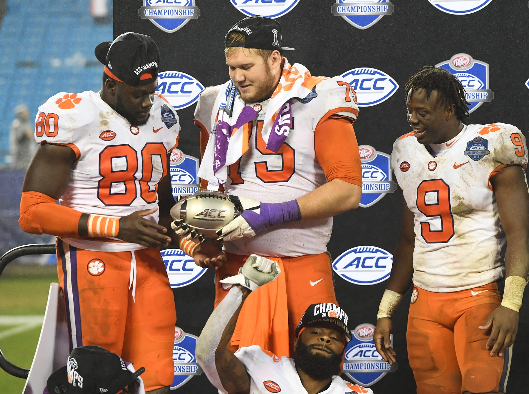 Clemson tight end Milan Richard (80) and offensive lineman Mitch Hyatt (75) hold the Dr. Pepper ACC Championship trophy after the Tigers 42-10 win over Pittsburgh at Bank of America Stadium in Charlotte, N.C. Saturday, December 1, 2018.