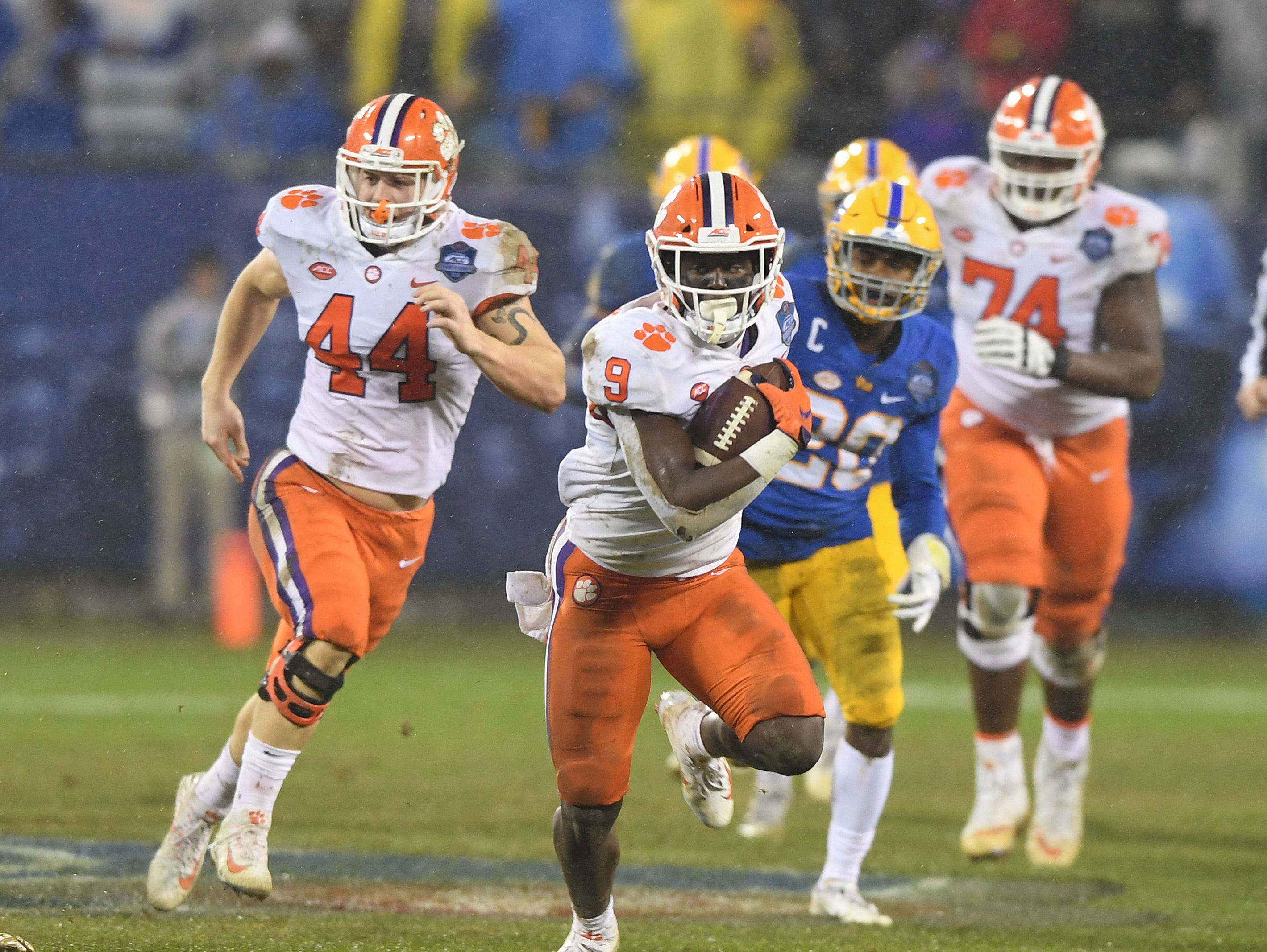 Clemson running back Travis Etienne (9) carries for a big gain against Pittsburgh during the 2nd quarter of the Dr. Pepper ACC Championship at Bank of America Stadium in Charlotte, N.C. Saturday, December 1, 2018.