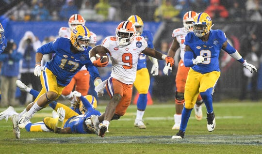 Clemson running back Travis Etienne (9) carries against Pittsburgh during the 2nd quarter of the Dr. Pepper ACC Championship at Bank of America Stadium in Charlotte, N.C. Saturday, December 1, 2018.