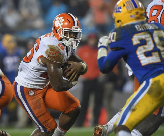 Clemson running back Adam Choice (26) carries against Pittsburgh during the 4th quarter of the Dr. Pepper ACC Championship at Bank of America Stadium in Charlotte, N.C. Saturday, December 1, 2018.