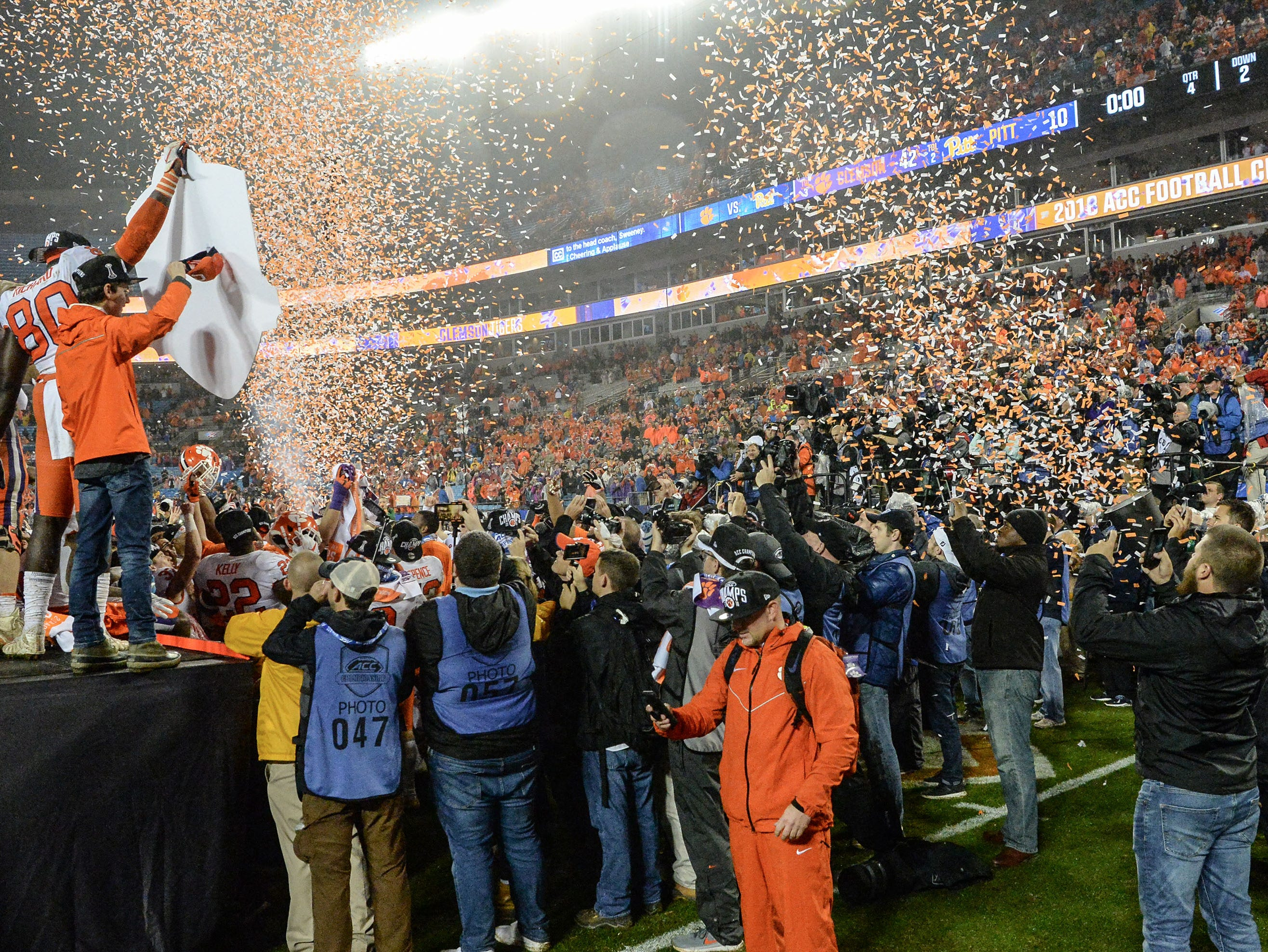 Clemson players and fans celebrate a 42-10 win over Pittsburgh after the game at the Dr. Pepper ACC football championship at Bank of America Stadium in Charlotte, N.C. on Saturday, December 1, 2018.