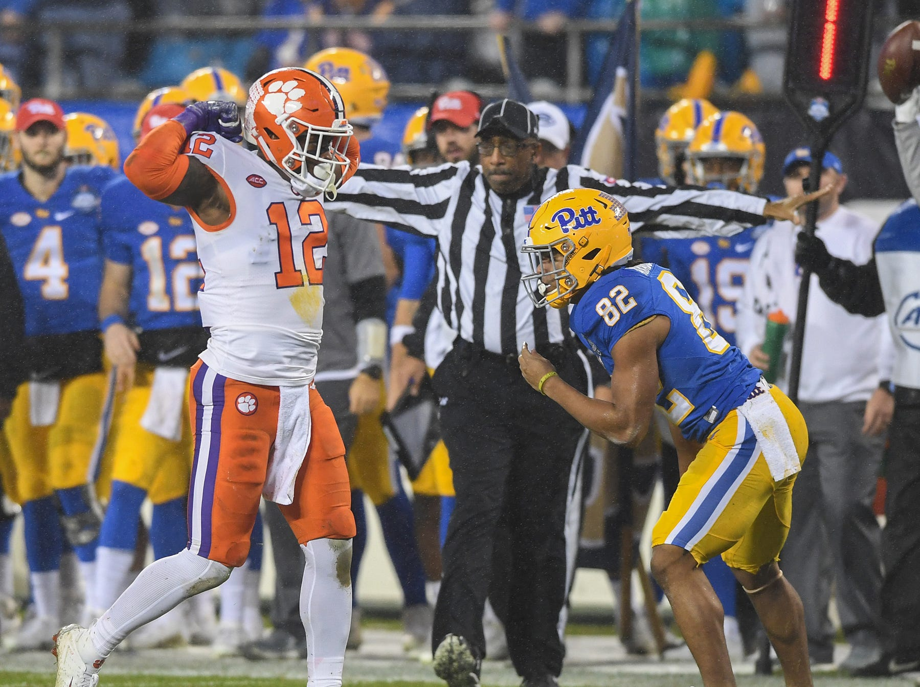 Clemson defensive back K'Von Wallace (12) reacts a defensive stop against Pittsburgh wide receiver Rafael Araujo-Lopes (82) during the 1st quarter of the Dr. Pepper ACC Championship at Bank of America Stadium in Charlotte, N.C. Saturday, December 1, 2018.