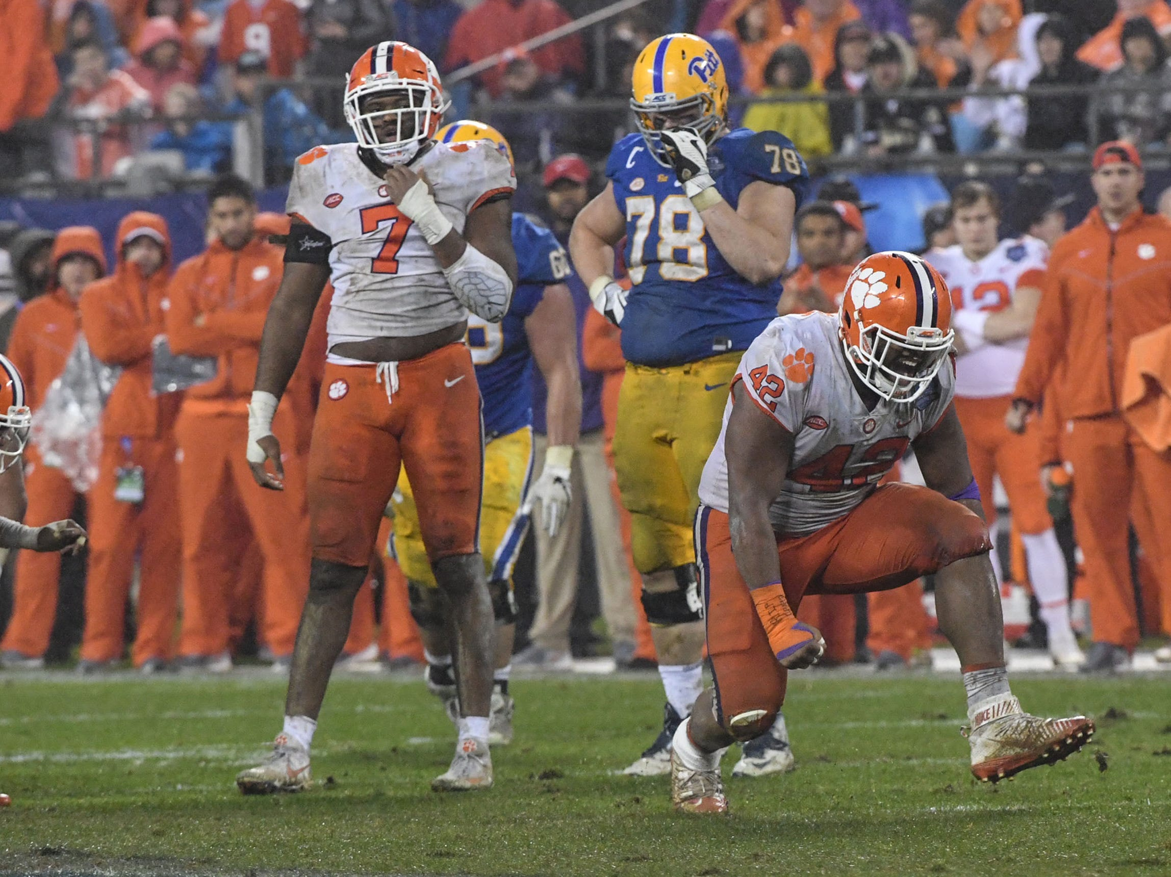 Clemson defensive lineman Christian Wilkins (42) reacts after tackling Pittsburgh running back Darrin Hall during the fourth quarter in Memorial Stadium on Saturday, November 3, 2018.