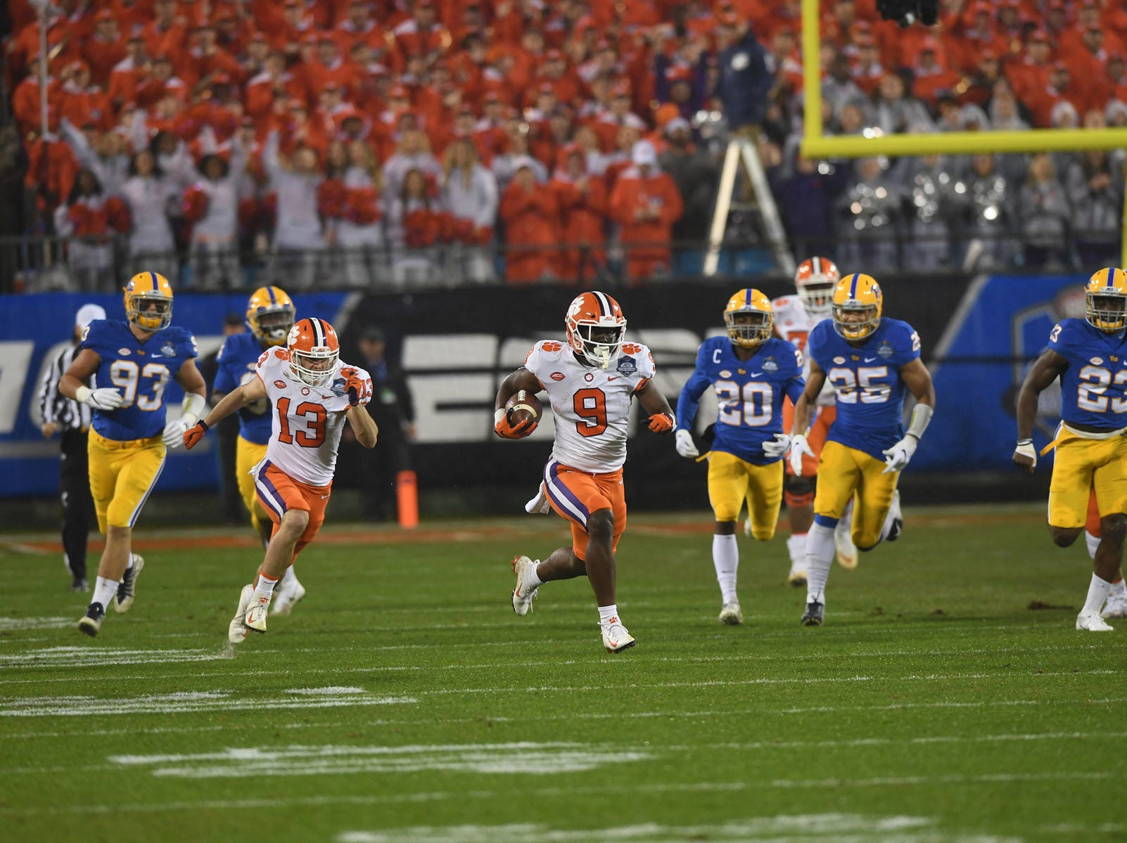 Clemson running back Travis Etienne (9) races 75 yards to score against Pittsburgh on the Tigers first play from scrimmage during the 1st quarter of the Dr. Pepper ACC Championship at Bank of America Stadium in Charlotte, N.C. Saturday, December 1, 2018.