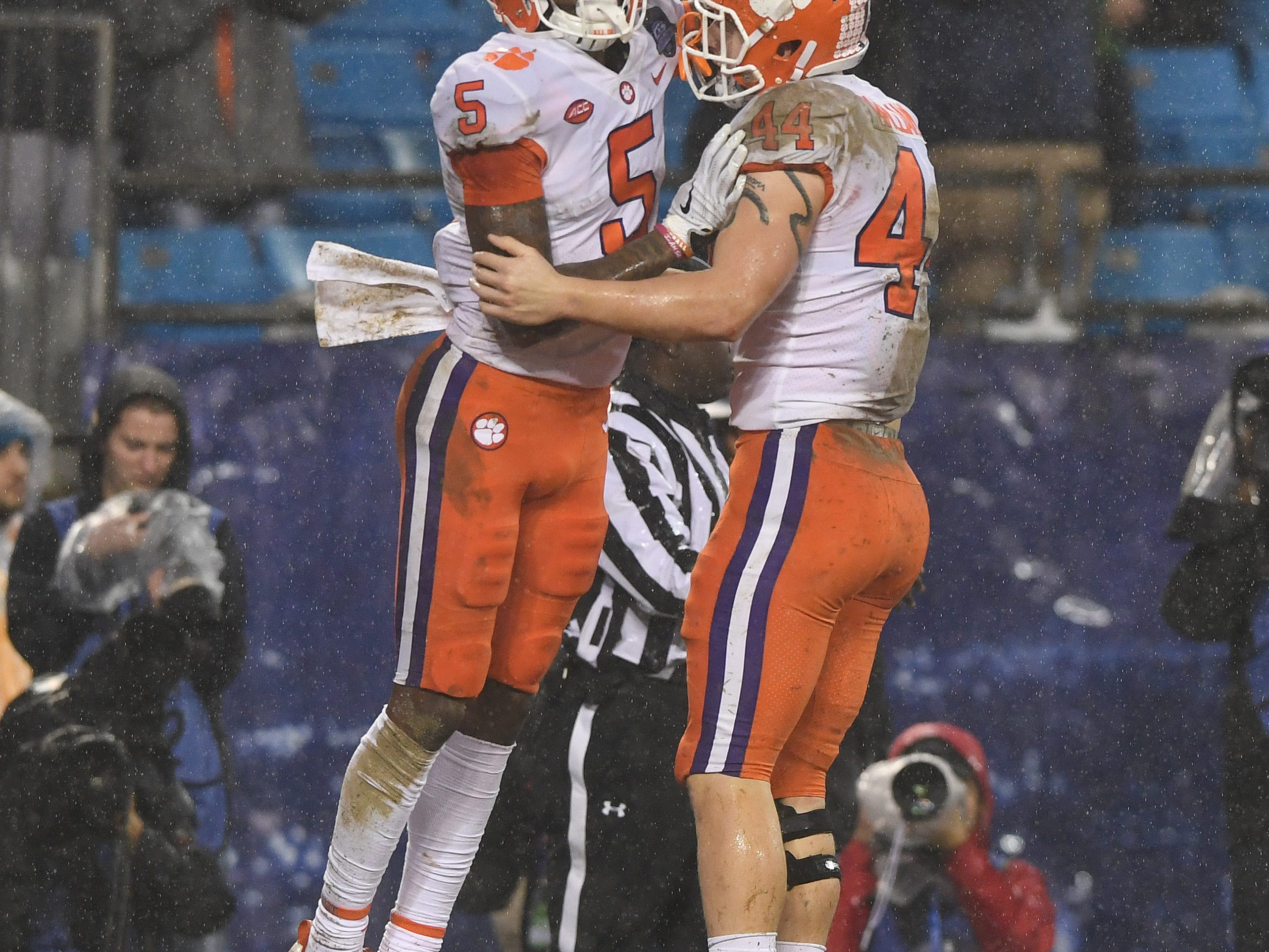 Clemson wide receiver Tee Higgins (5) celebrates with tight end Garrett Williams (44) after catching a TD against Pittsburgh during the 2nd quarter of the Dr. Pepper ACC Championship at Bank of America Stadium in Charlotte, N.C. Saturday, December 1, 2018.