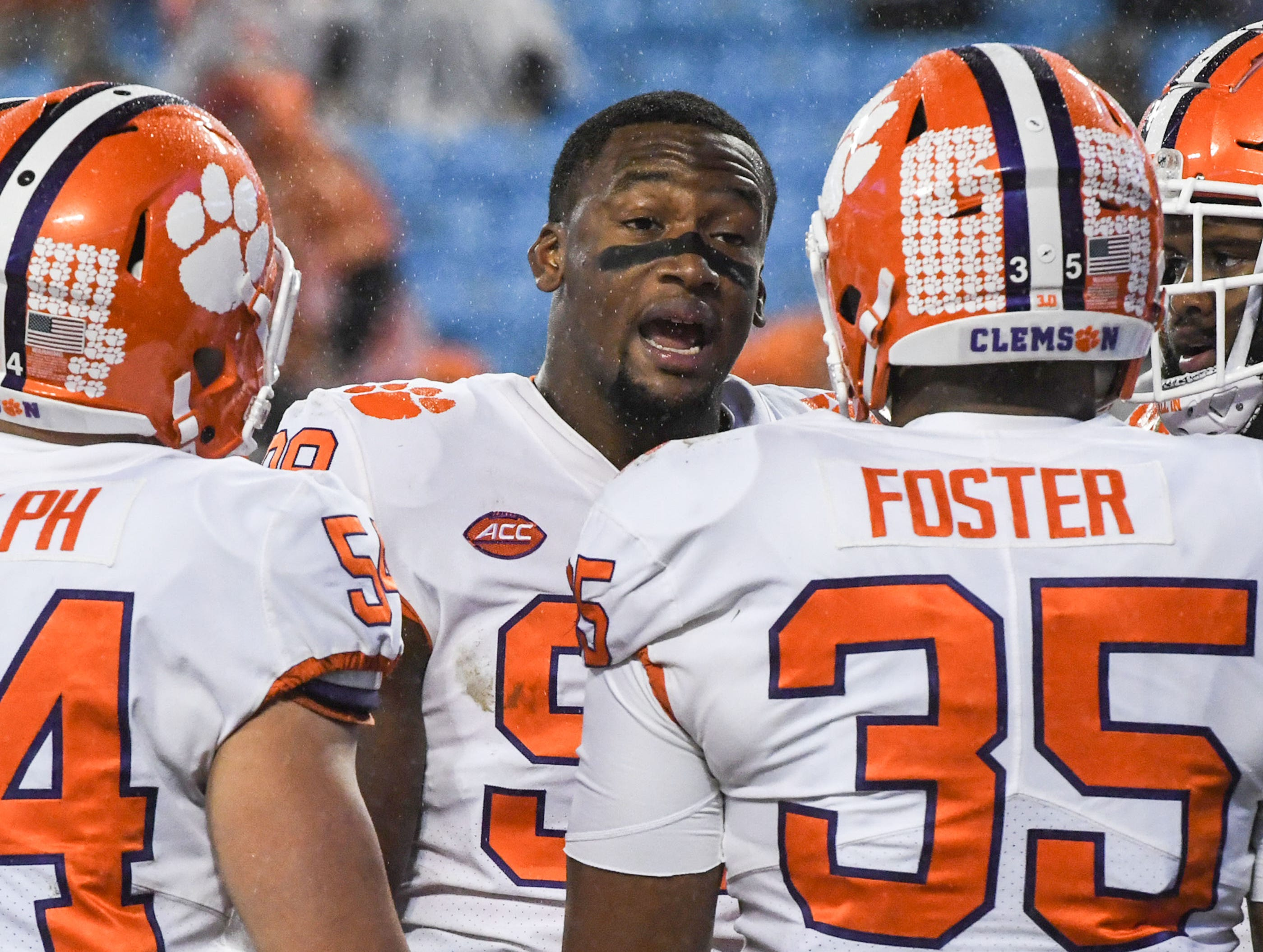 Clemson defensive lineman Clelin Ferrell (99) talks with teammates before the game of the Dr. Pepper ACC football championship at Bank of America Stadium in Charlotte, N.C. on Saturday, December 1, 2018.