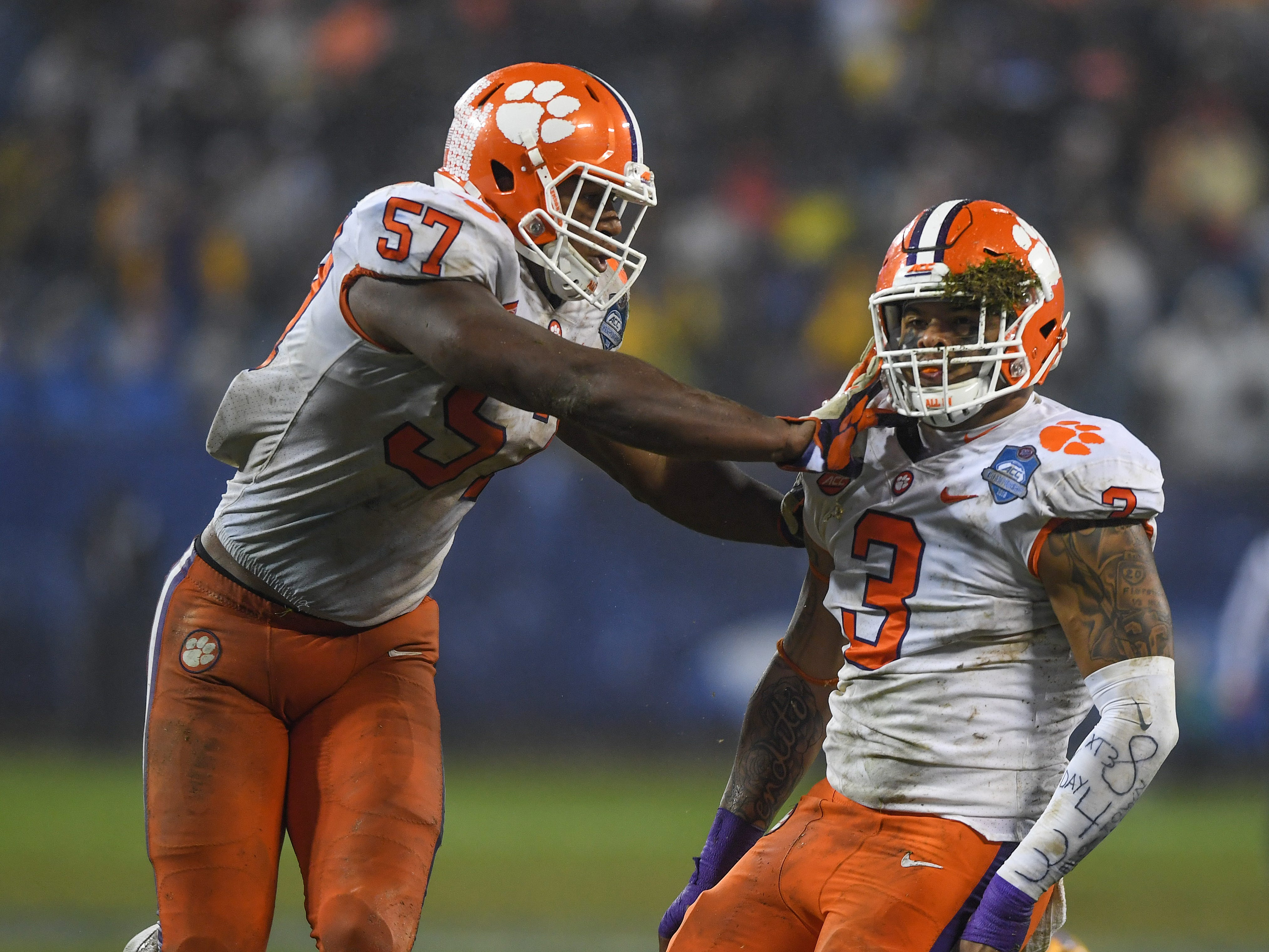 Clemson defensive lineman Xavier Thomas (3) celebrates with linebacker Tre Lamar (57) after stopping Pittsburgh running back Qadree Ollison (30) during the 3rd quarter of the Dr. Pepper ACC Championship at Bank of America Stadium in Charlotte, N.C. Saturday, December 1, 2018.