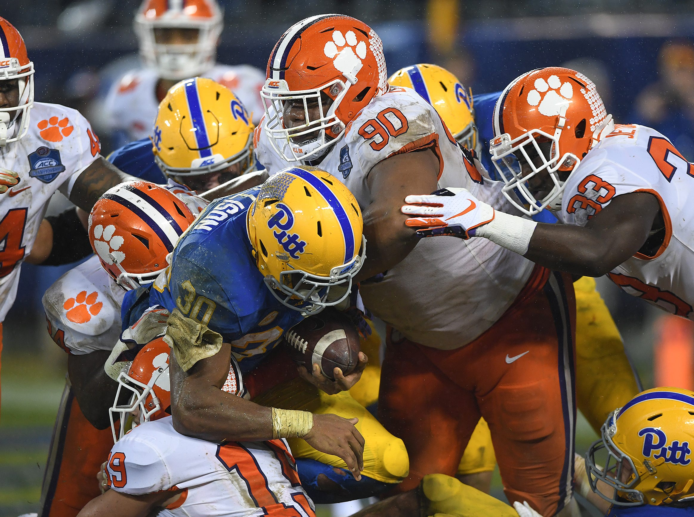 Clemson defensive back Tanner Muse (19), linebacker Kendall Joseph (34), and defensive lineman Dexter Lawrence (90) stop Pittsburgh running back Qadree Ollison (30) at the goal line during the 2nd quarter of the Dr. Pepper ACC Championship at Bank of America Stadium in Charlotte, N.C. Saturday, December 1, 2018.