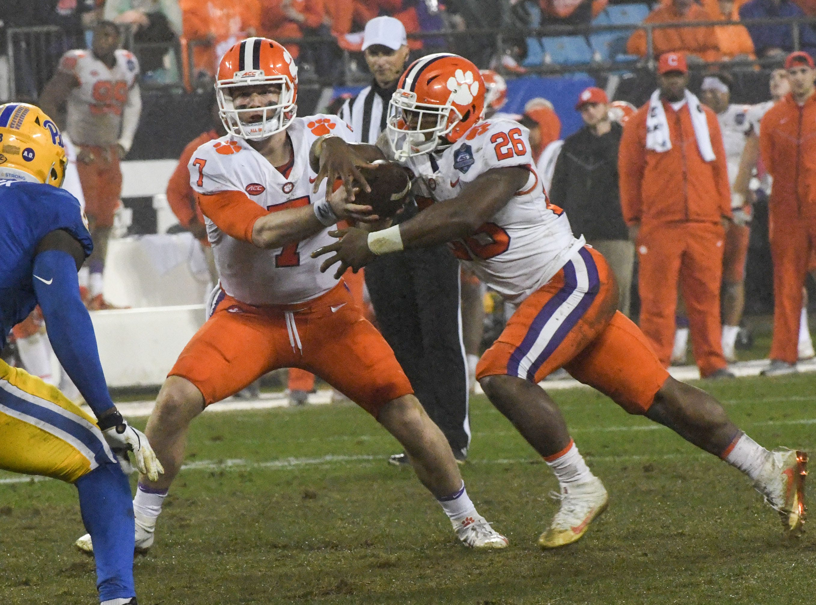 Clemson quarterback Chase Brice (7) hands off to running back Adam Choice (26) during the fourth quarter in Memorial Stadium on Saturday, November 3, 2018.