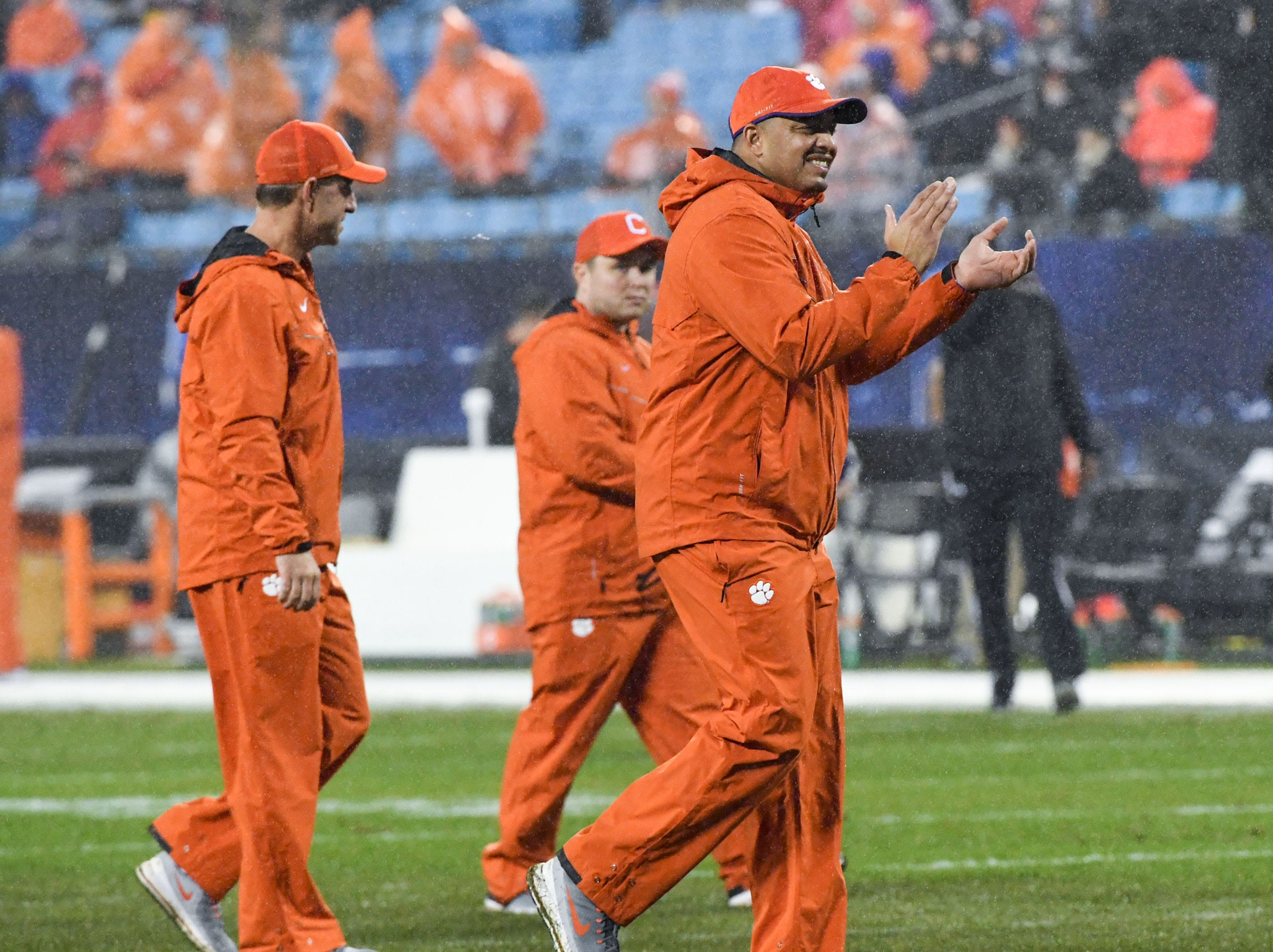 Clemson co-offensive coordinator Tony Elliott, right, claps near Clemson Head Coach Dabo Swinney, left, before the game of the Dr. Pepper ACC football championship at Bank of America Stadium in Charlotte, N.C. on Saturday, December 1, 2018.