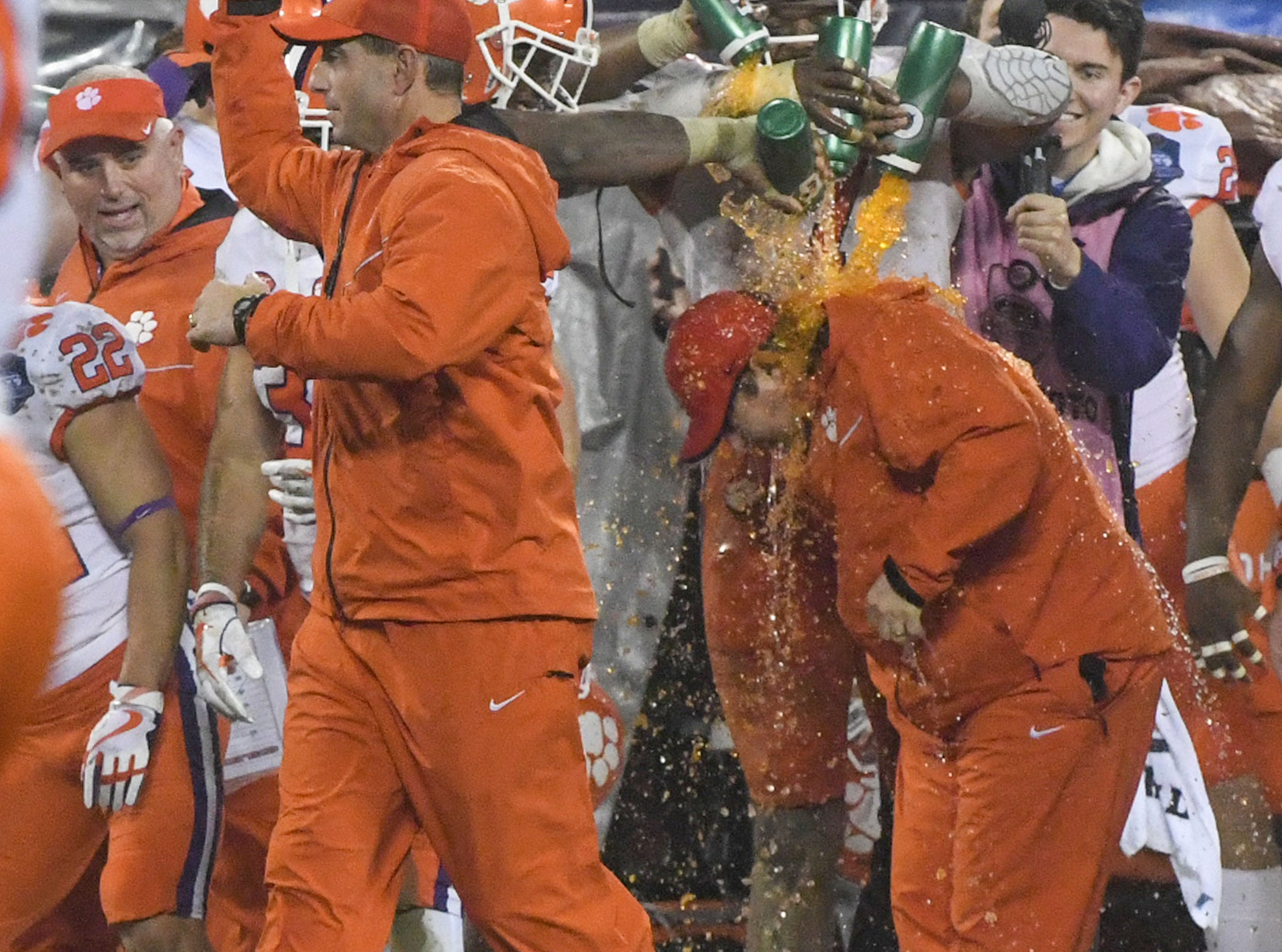 Clemson Head Coach Dabo Swinney walks by players dousing a coach with Gatorade during the fourth quarter in Memorial Stadium on Saturday, November 3, 2018.
