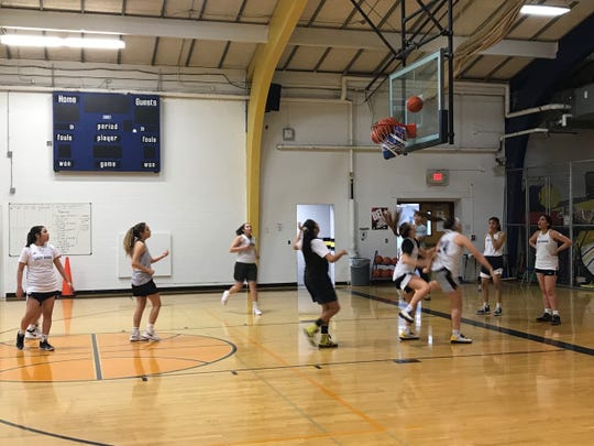 The defending state Class C champion Box Elder Bears girls' basketball team prepares for the coming season by working on a rebounding drill during a recent practice in Box Elder.
