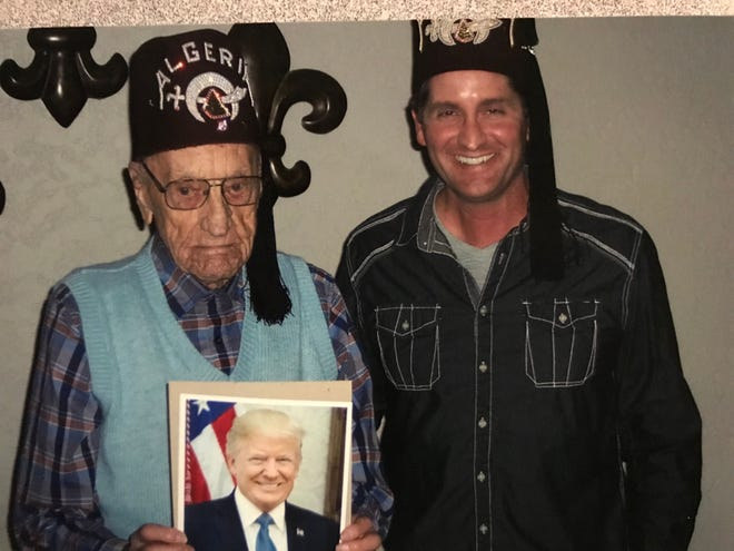 Frank Pehrson of Chinook was recently presented a plaque and photograph from President Donald J. Trump at the Central Montana Shrine Club meeting. Presenting the plaque and photograph is Kelly Brandon of the Shriners, whose father, Bob, wrote to the president about Pehrson's WWII service. The president responded with the mementos to honor the 98-year-old Pehrson.