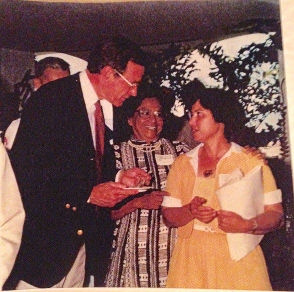 """President George H.W. Bush speaking with former Senator Carmen Artero Kasperbauer, right, during his historic visit to Guam in the early 1980s. Former Senator Concepcion """"Chong"""" Barrett is in the middle."""