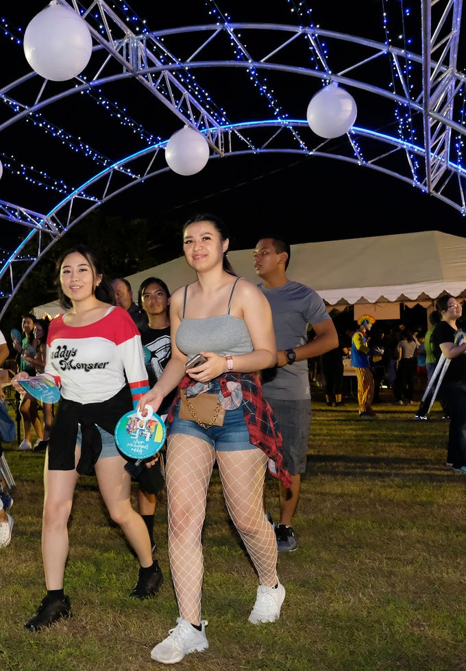 K-pop fans Jasmine Superales and Kaitlyn Garthe arrive at the MBC Music K-Pop Concert on Saturday evening, December 1, 2018 at the Governor Joseph Flores Memorial Park.