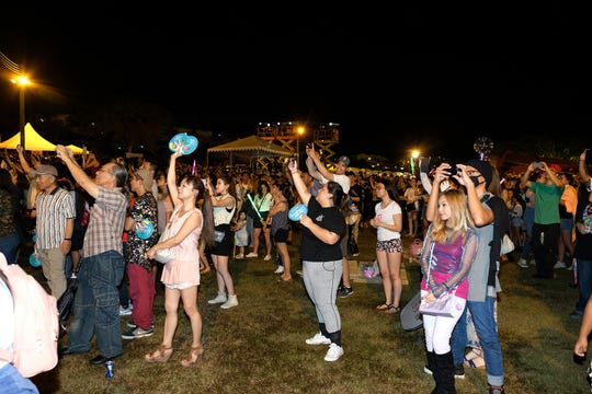 The crowd cheers at the MBC Music K-Pop Concert Saturday evening, December 1, 2018 at the Governor Joseph Flores Memorial Park.