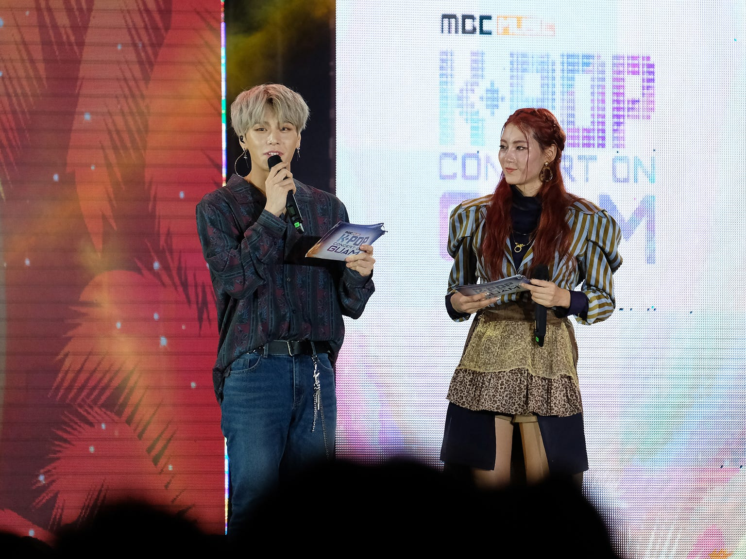 Kenta of JBJ95 and a member of  H.U.B. speak to the audience at the MBC Music K-Pop Concert on Saturday evening, December 1, 2018 at the Governor Joseph Flores Memorial. Park