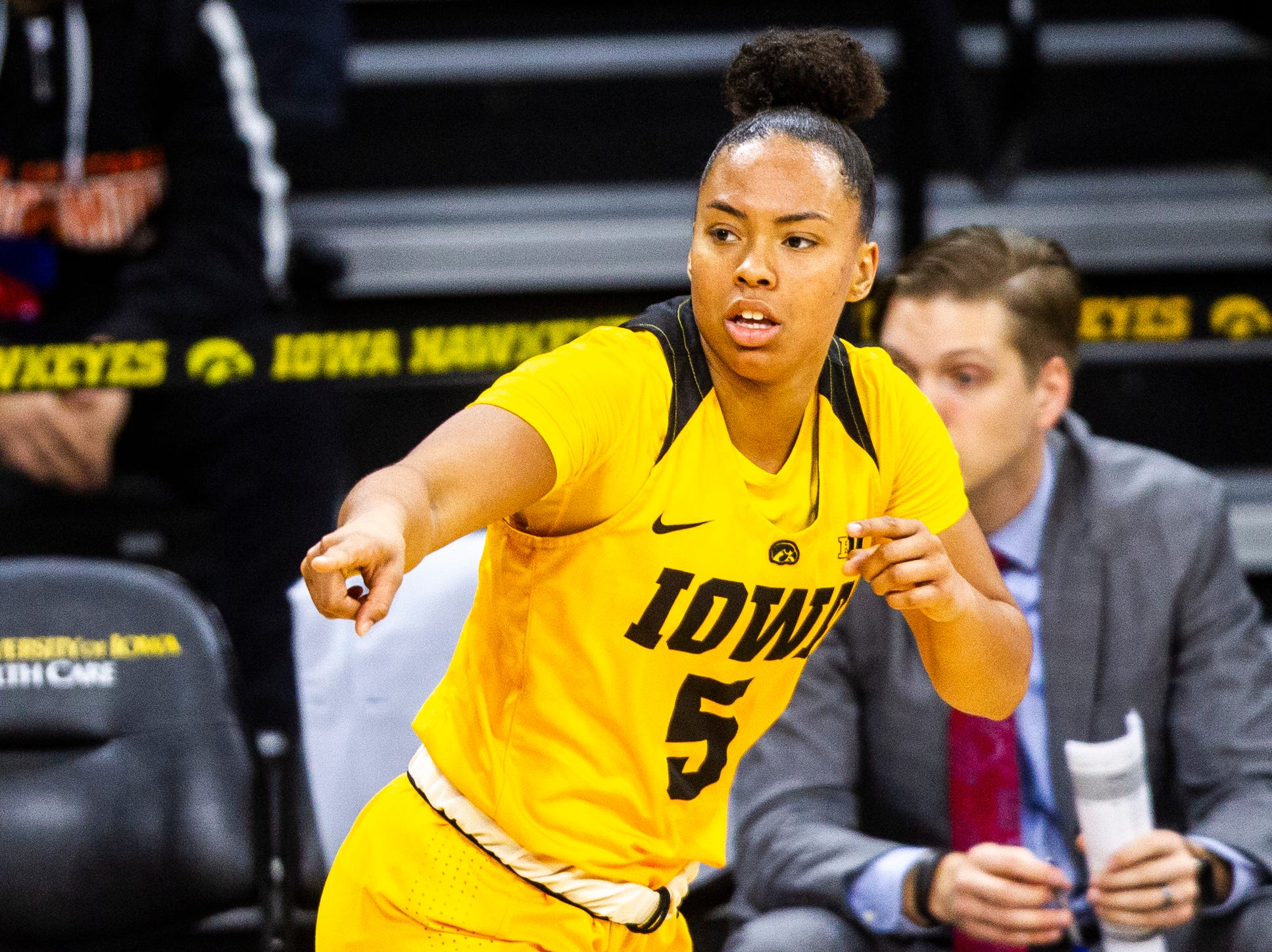 Iowa guard Alexis Sevillian (5) gestures after making a 3-point basket during a NCAA women's basketball game on Sunday, Dec. 2, 2018, at Carver-Hawkeye Arena in Iowa City.