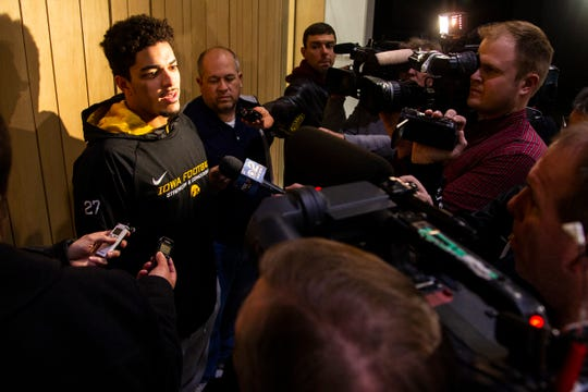 Iowa defensive back Amani Hooker talks with reporters during an Outback Bowl announcement press conference on Sunday, Dec. 2, 2018, at the Hansen Football Performance Center in Iowa City.