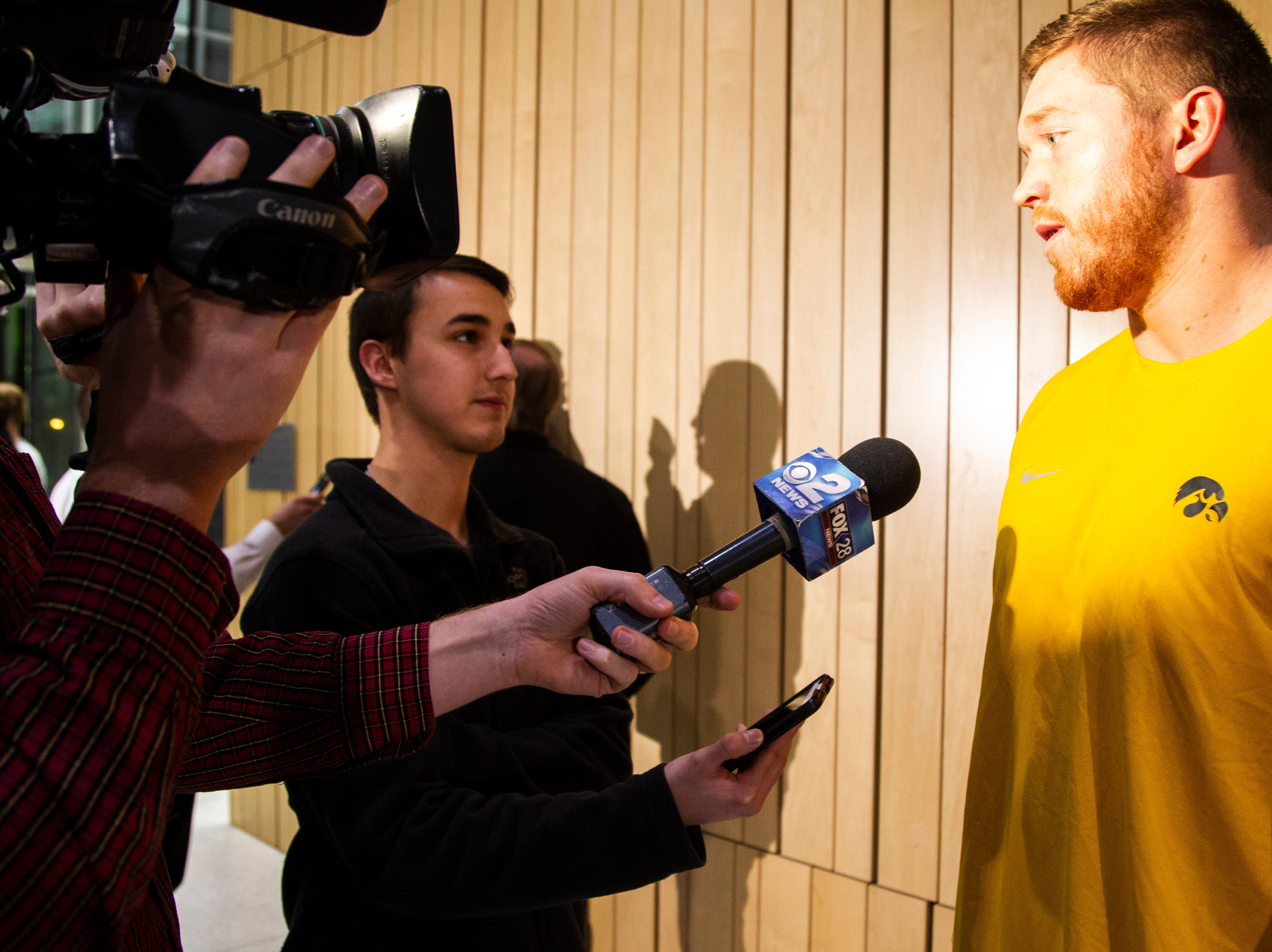 Iowa defensive end Parker Hesse talks with reporters during an Outback Bowl announcement press conference on Sunday, Dec. 2, 2018, at the Hansen Football Performance Center in Iowa City.
