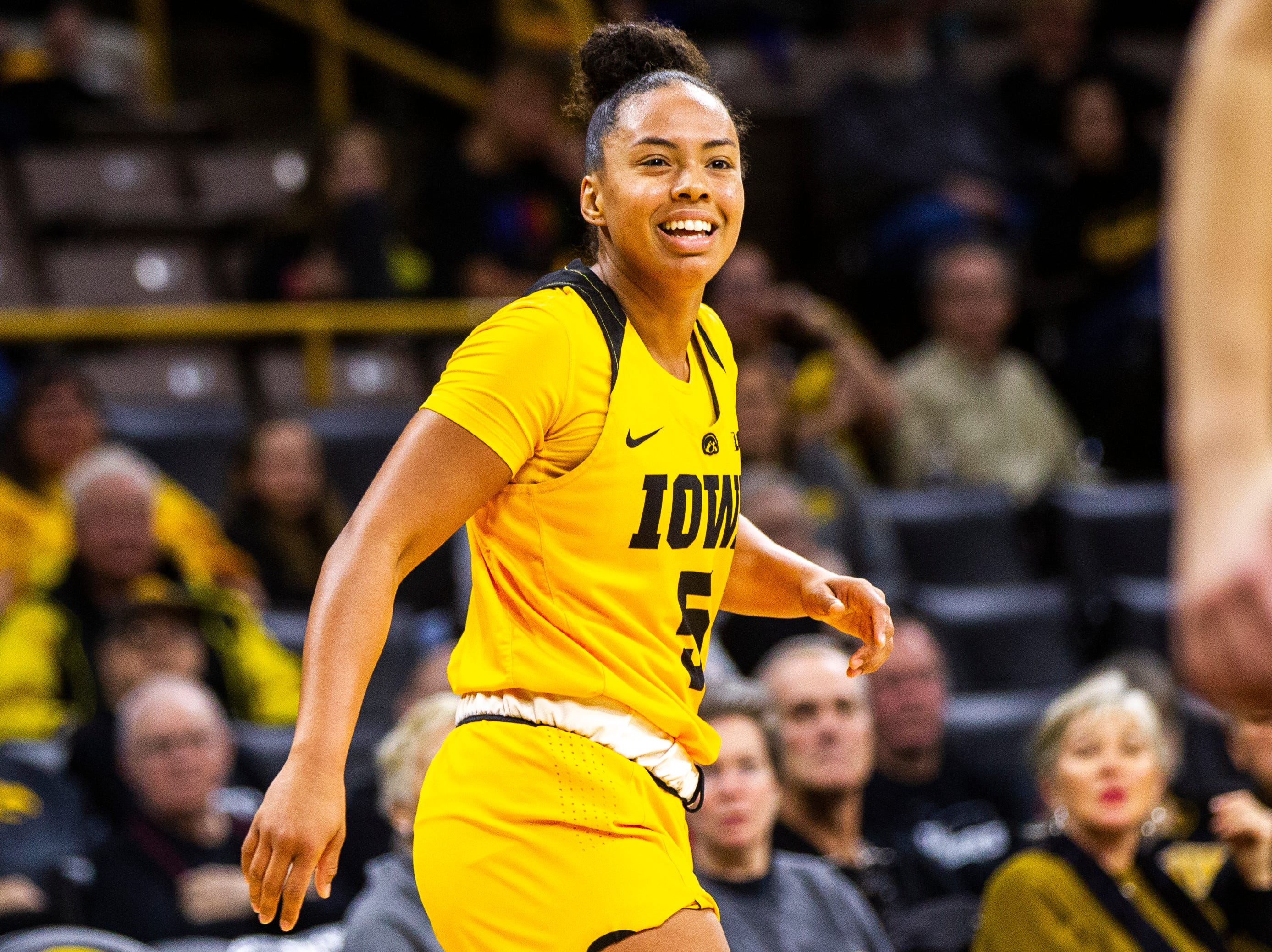 Iowa guard Alexis Sevillian (5) smiles after making a 3-point basket during a NCAA women's basketball game on Sunday, Dec. 2, 2018, at Carver-Hawkeye Arena in Iowa City.