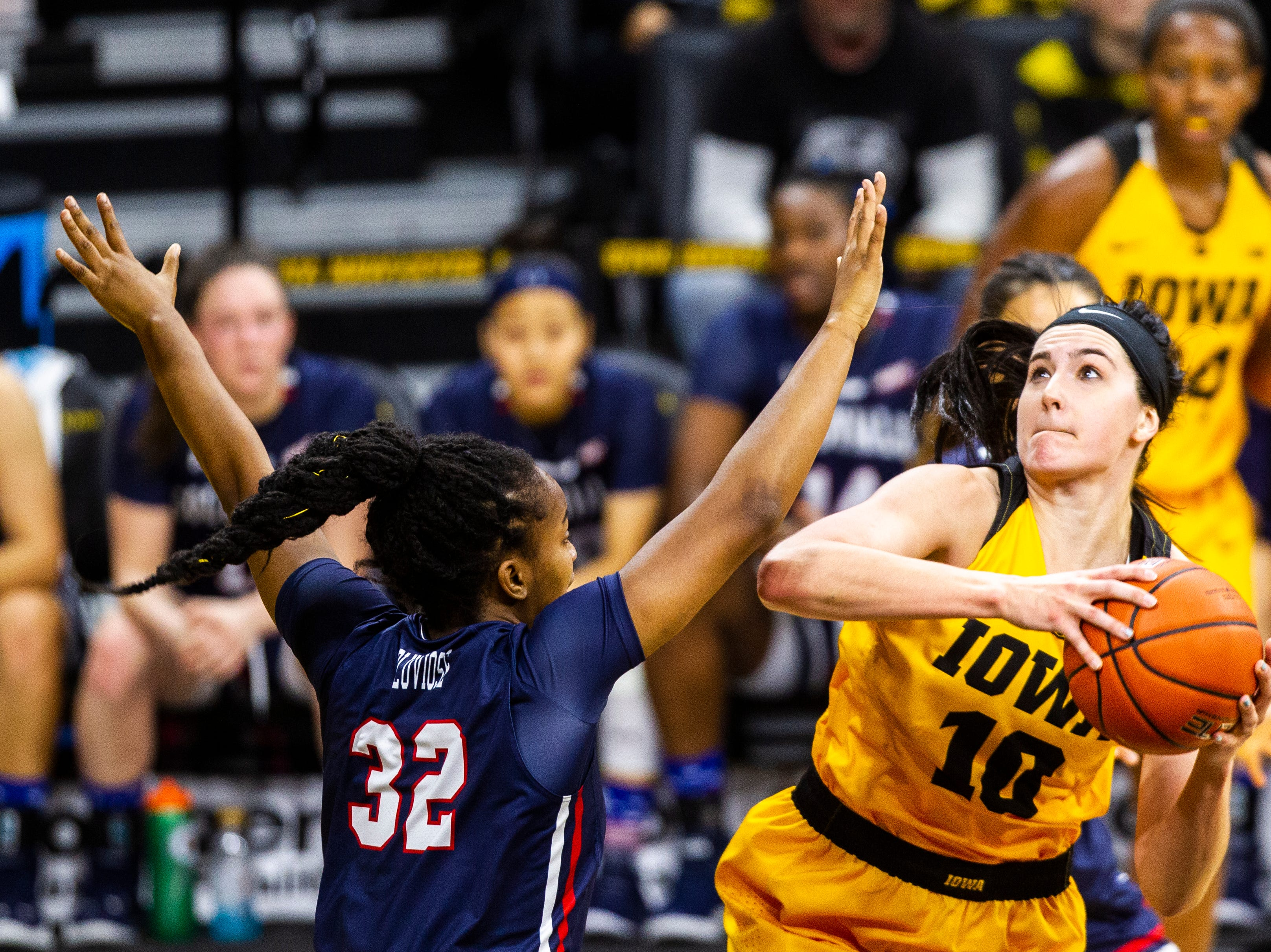 Iowa forward Megan Gustafson (10) attempts a basket past Robert Morris' Nade'ge Pluviose (32) during a NCAA women's basketball game on Sunday, Dec. 2, 2018, at Carver-Hawkeye Arena in Iowa City.