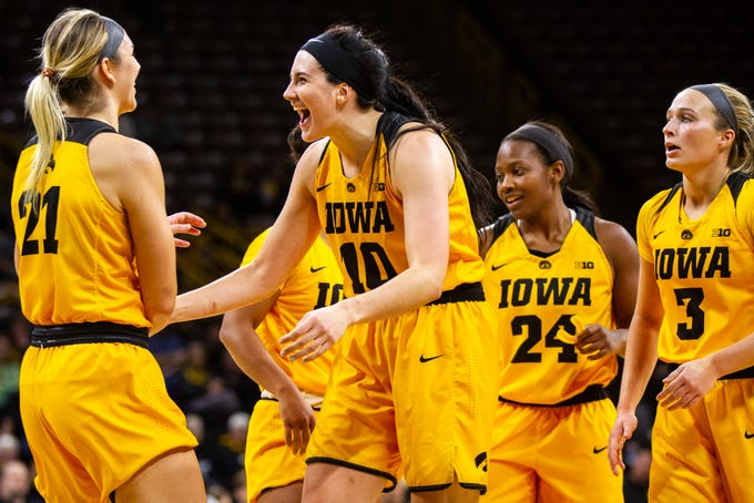 Iowa forward Megan Gustafson (10) celebrates with Iowa forward Hannah Stewart (21) during a NCAA women's basketball game on Sunday, Dec. 2, 2018, at Carver-Hawkeye Arena in Iowa City.