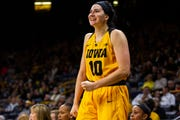 Iowa forward Megan Gustafson (10) cheers on her teammates during a NCAA women's basketball game on Sunday, Dec. 2, 2018, at Carver-Hawkeye Arena in Iowa City.