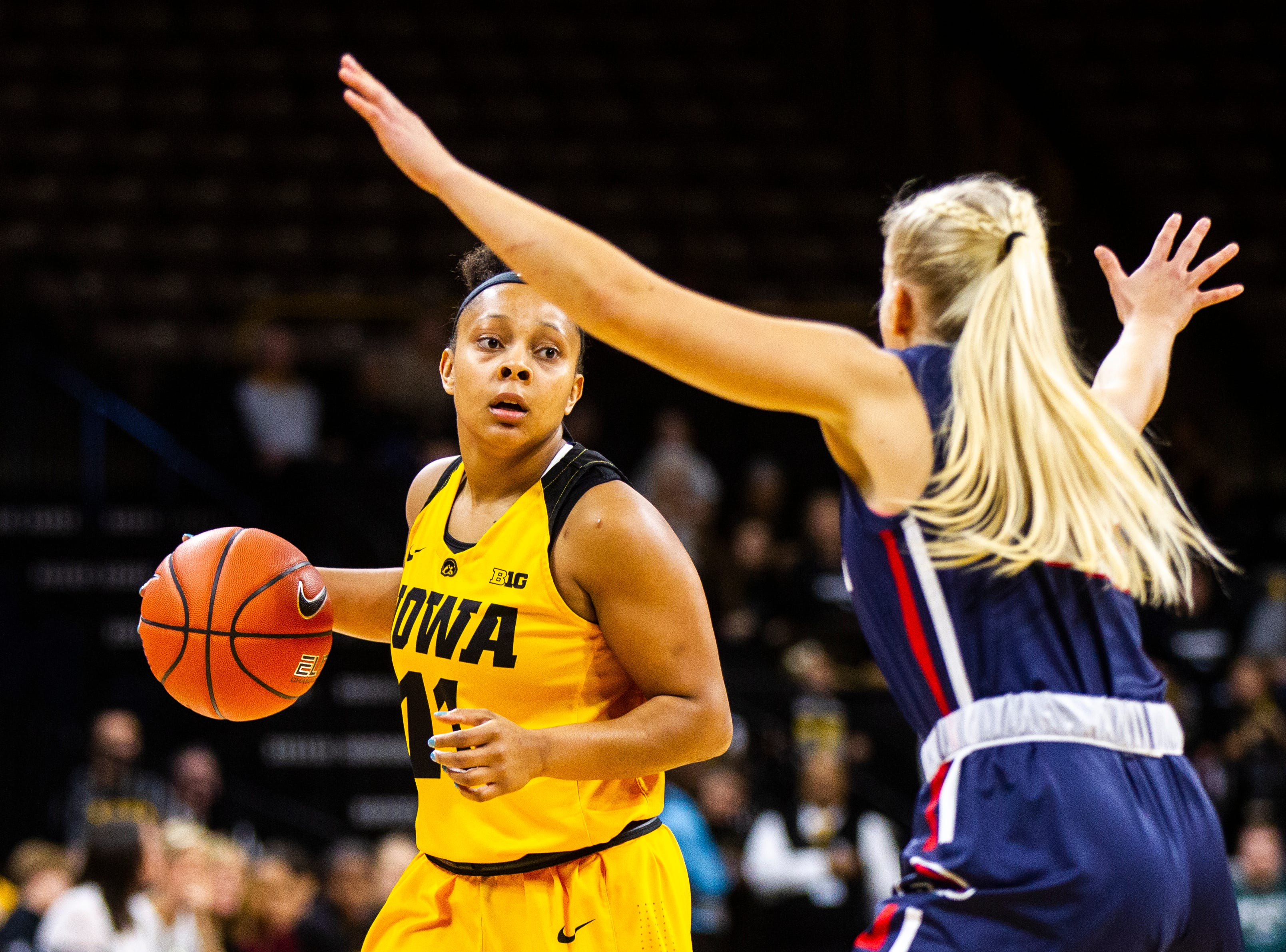 Iowa guard Tania Davis (11) looks to pass during a NCAA women's basketball game on Sunday, Dec. 2, 2018, at Carver-Hawkeye Arena in Iowa City.