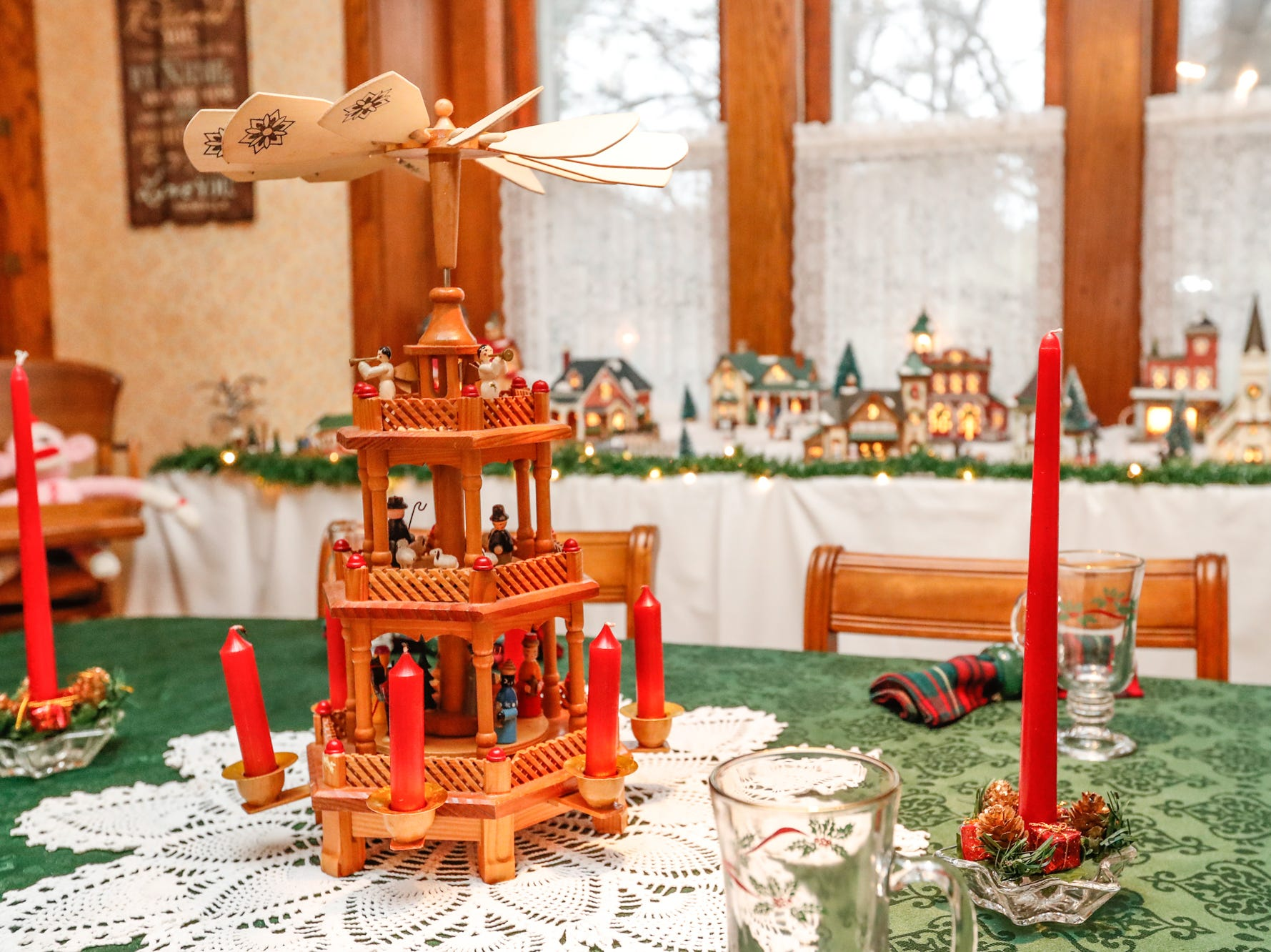 A candle powered windmill decorates the dining room in the 1903 home belonging to Ruth and Russell Schwartz, during the Carmel Clay Historical Society Holiday Home Tour in Carmel Ind. on Saturday, Dec.1, 2018.