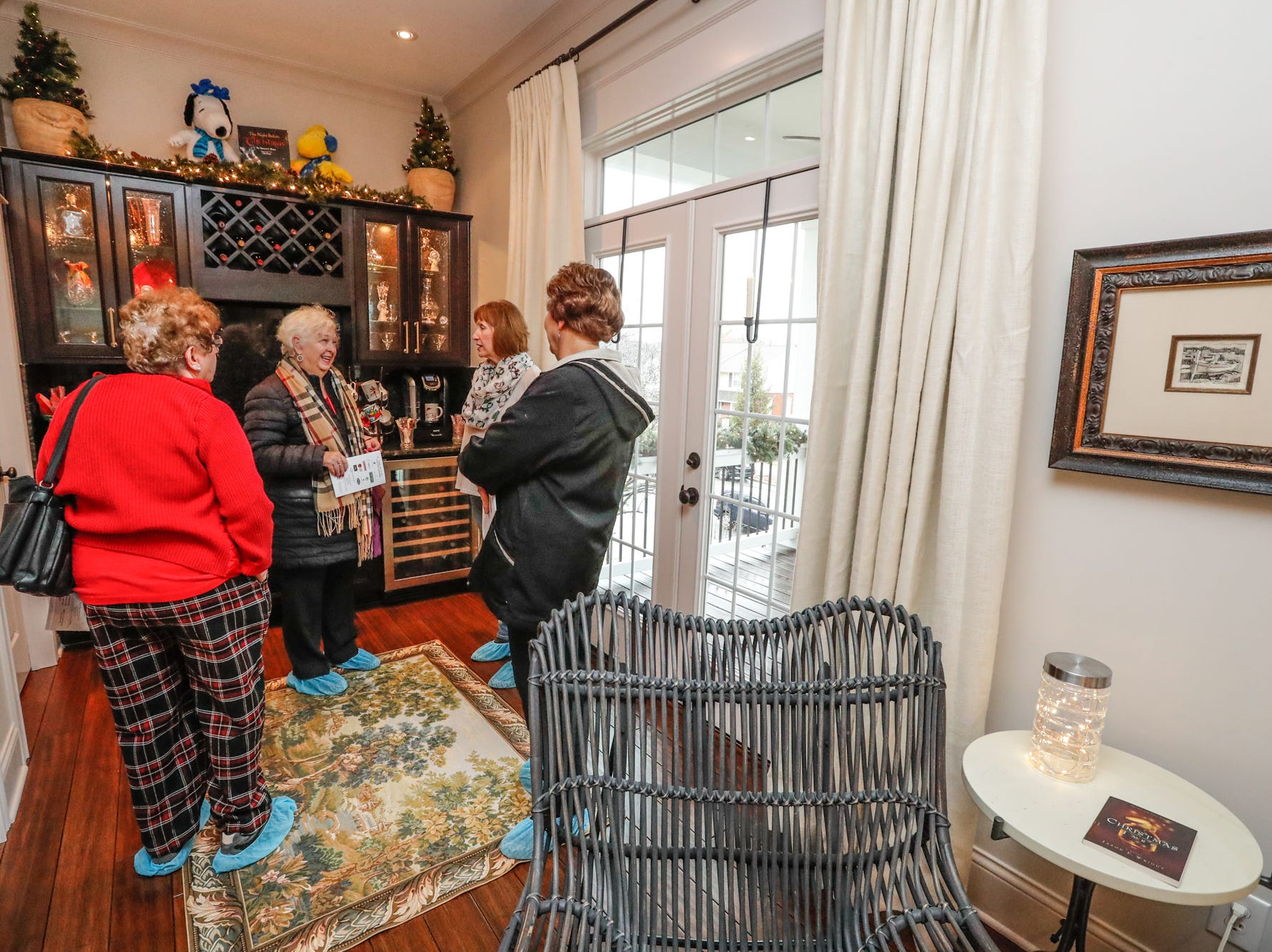 Guests tour the second floor of the contemporary plantation-style home belonging to Lezlie and Terry Heath with grand front porches and lots of space for entertaining, during the Carmel Clay Historical Society Holiday Home Tour in Carmel Ind. on Saturday, Dec.1, 2018. The couples son, Craig Heath, helped to design the home.