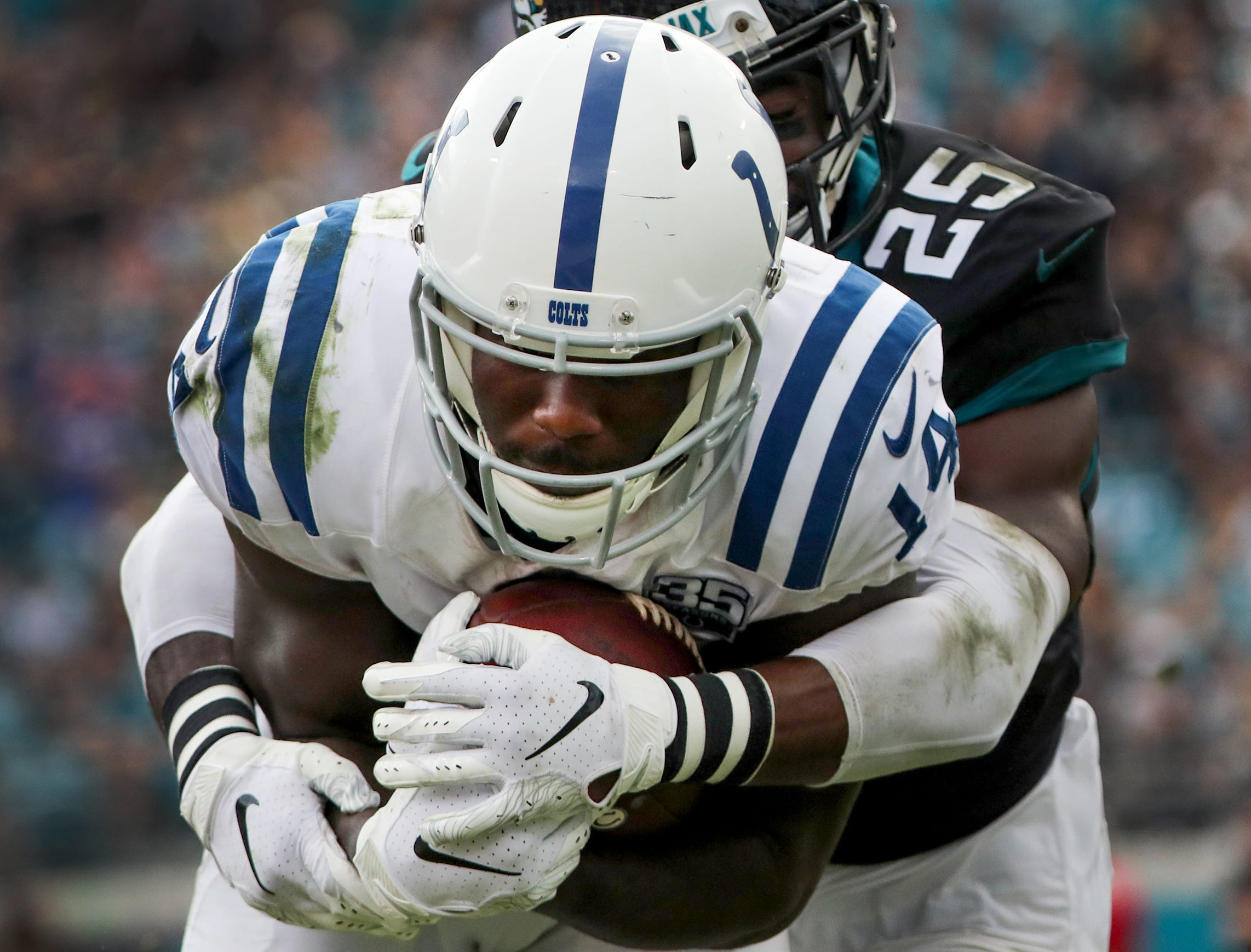 Indianapolis Colts wide receiver Zach Pascal (14) is hit by Jacksonville Jaguars defensive back D.J. Hayden (25) in the second half of their game at TIAA Bank Field on Thursday, Dec. 2, 2018. The Jacksonville Jaguars defeated the Colts 6-0.