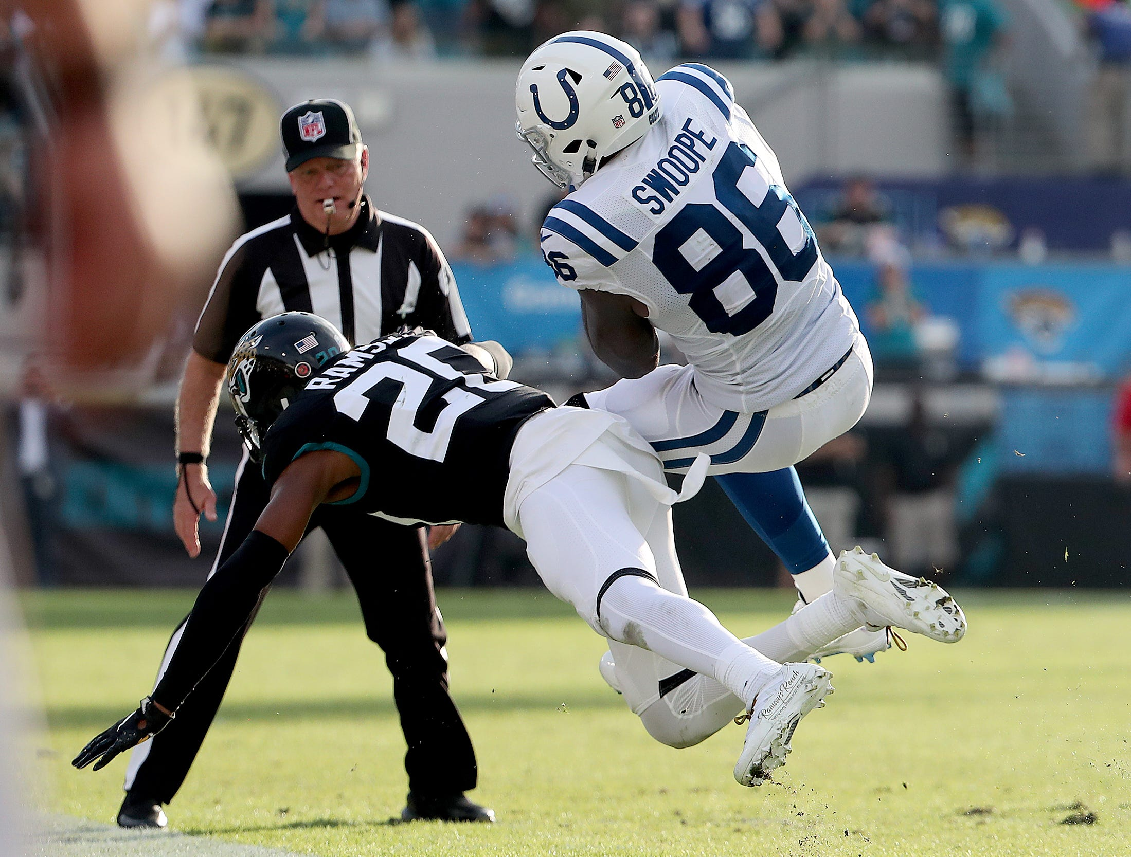 Indianapolis Colts tight end Erik Swoope (86) catches the ball and hit by Jacksonville Jaguars cornerback Jalen Ramsey (20) on the final play of their game at TIAA Bank Field on Thursday, Dec. 2, 2018. The Jacksonville Jaguars defeated the Colts 6-0.