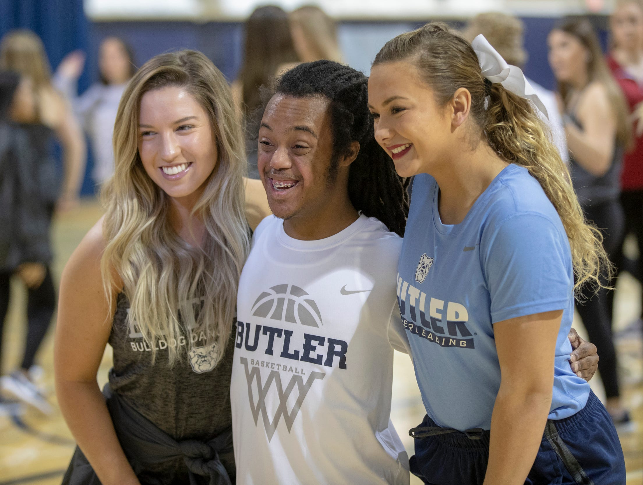 Evan Guess (middle), poses for a photo with dancer Cassidy Turkovich (left), and cheerleader Emma Pippen, after they rehearse for a special halftime performance during the Butler women's basketball game at Hinkle Fieldhouse, Indianapolis, Sunday, Dec. 2, 2018. Butler cheer and dance groups paired up with physical therapy students from Indiana University to teach young people with special needs a routine in preparation for a special performance during the afternoon's halftime show.