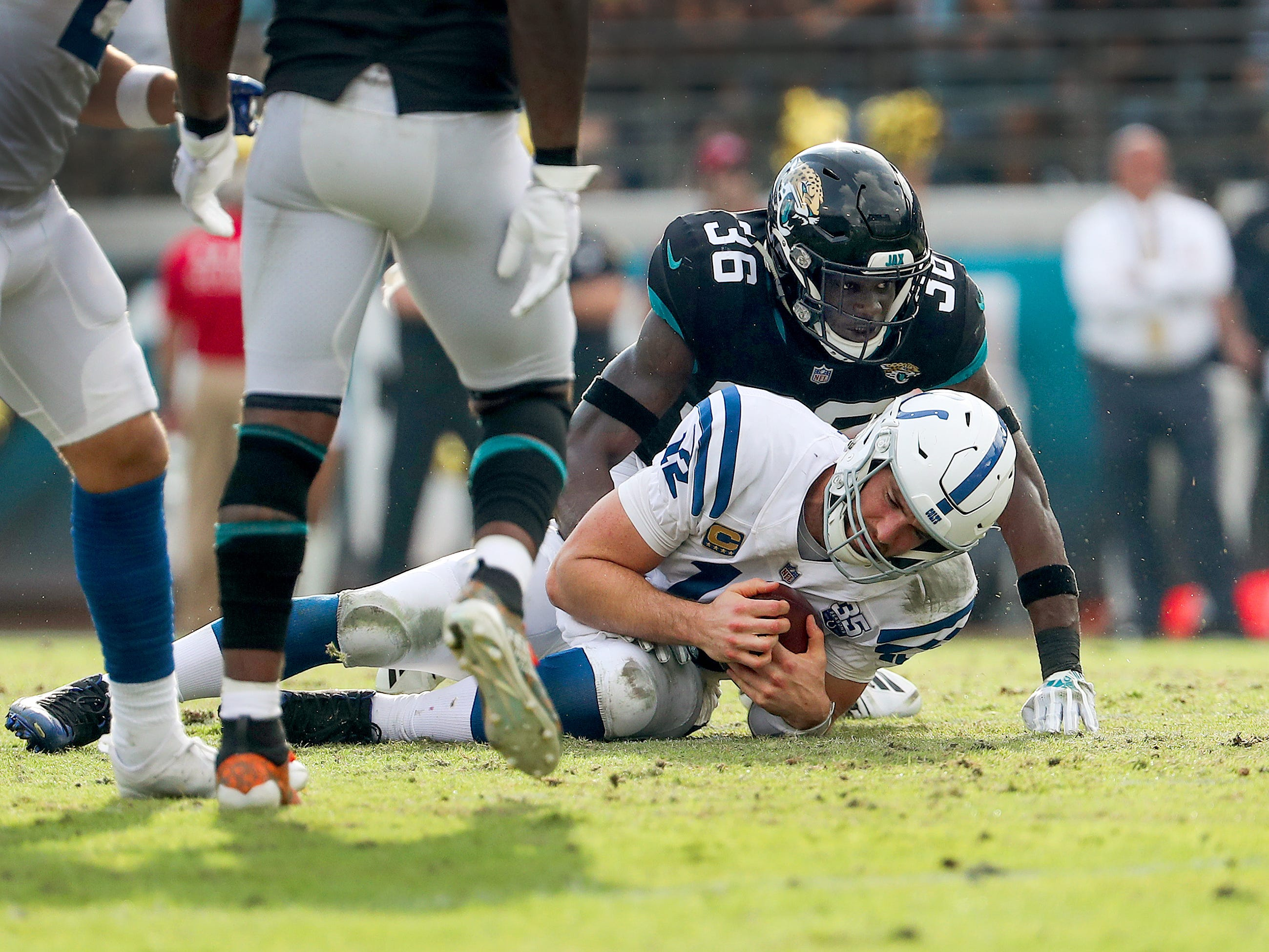Indianapolis Colts quarterback Andrew Luck (12) is sacked by Jacksonville Jaguars defensive back Ronnie Harrison (36) in the second half of their game at TIAA Bank Field on Thursday, Dec. 2, 2018. The Jacksonville Jaguars defeated the Colts 6-0.