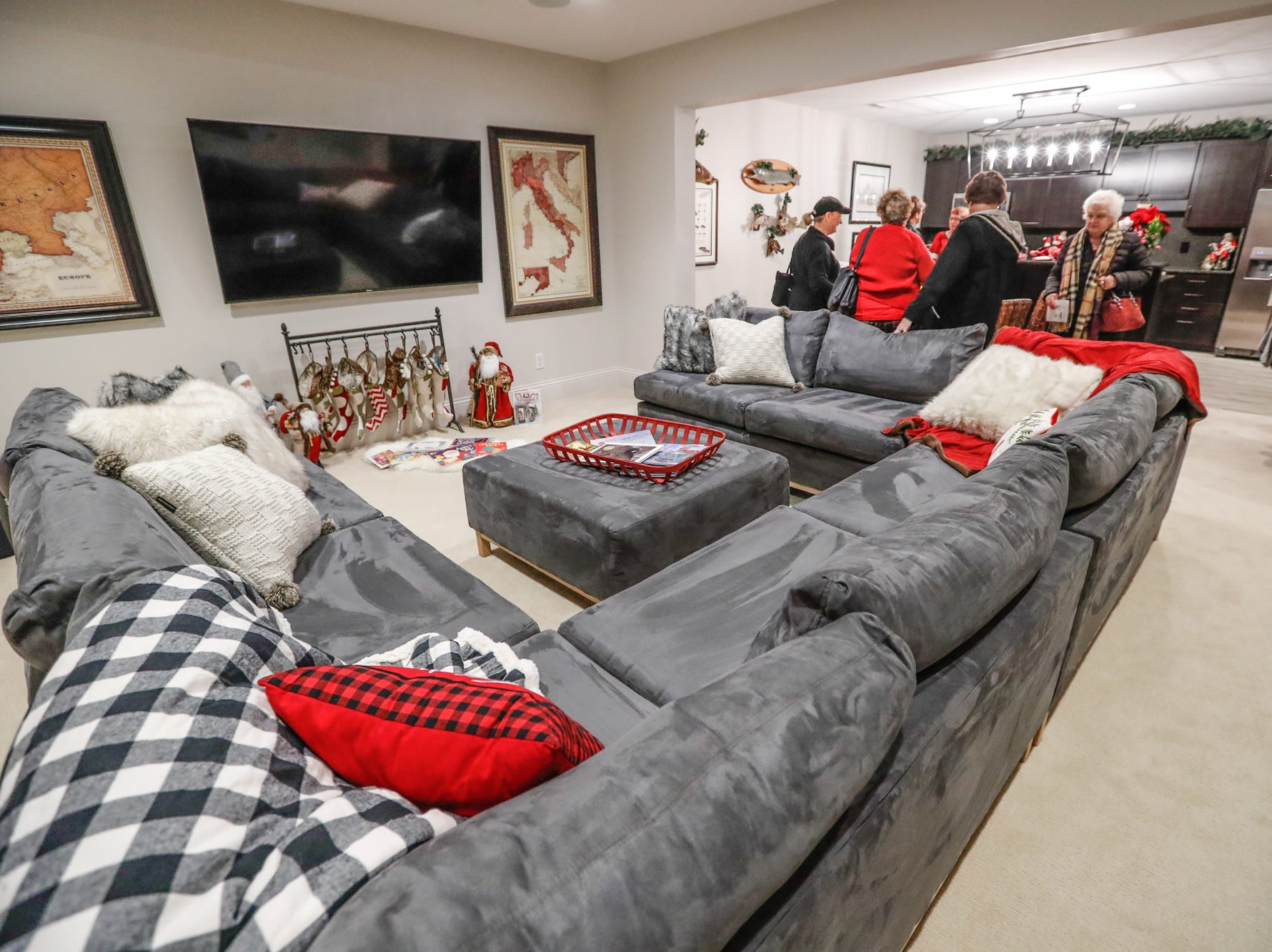 The contemporary plantation-style home belonging to Lezlie and Terry Heath features an open concept basement set up for entertaining during the Carmel Clay Historical Society Holiday Home Tour in Carmel Ind. on Saturday, Dec.1, 2018. The couples son, Craig Heath, helped to design the home.