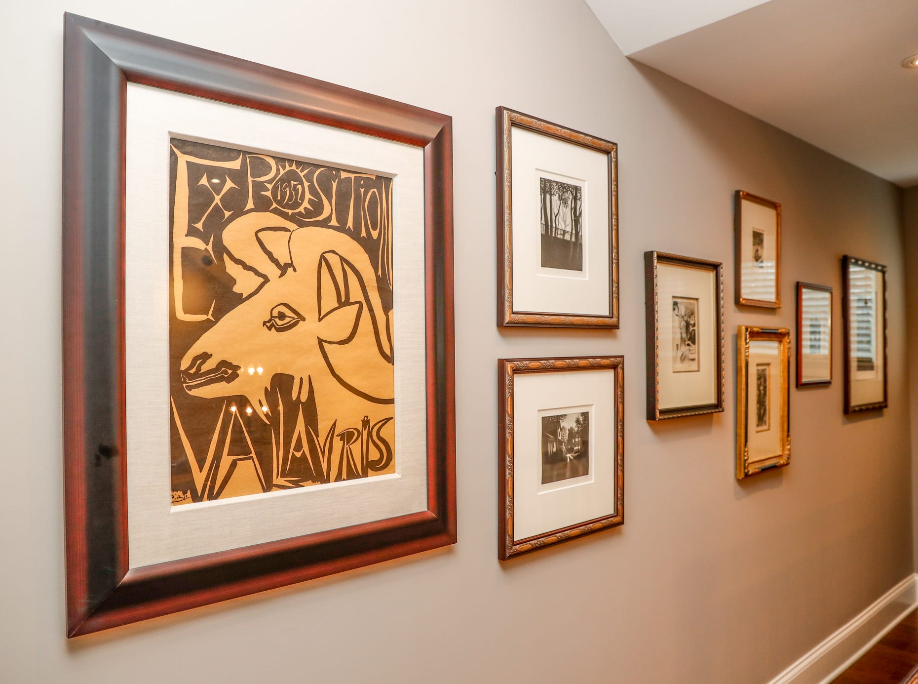 Fine art prints hang the home of Brad Sexauer during the Carmel Clay Historical Society Holiday Home Tour in Carmel Ind. on Saturday, Dec.1, 2018. The home features an array of fine art, and an open concept floor plan.