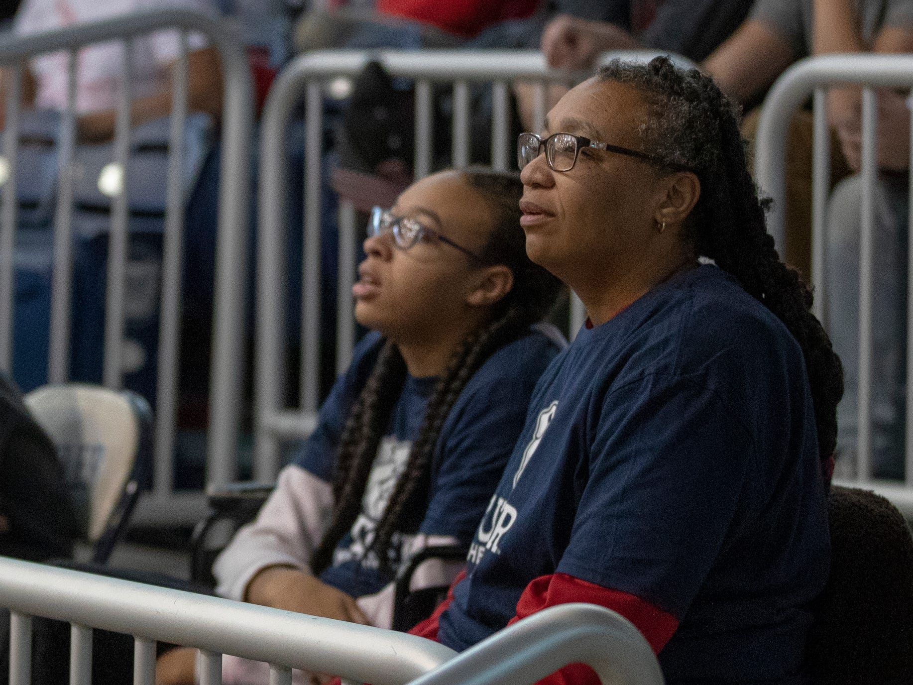 Yolanda Ward-Lee (right), sits with her daughter Kiara Lee, 19, and son at a special halftime performance during the Butler women's basketball game at Hinkle Fieldhouse, Indianapolis, Sunday, Dec. 2, 2018. Butler cheer and dance groups paired up with physical therapy students from Indiana University to teach young people with special needs a routine in preparation for a special performance during the afternoon's halftime show.