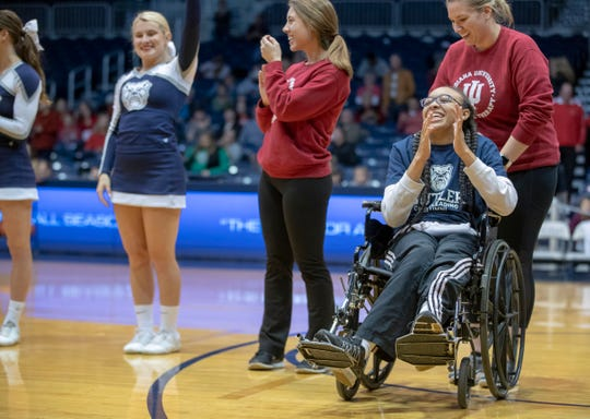 Kiara Lee smiles as she takes part in a special halftime performance during the Butler women's basketball game at Hinkle Fieldhouse, Indianapolis, Sunday, Dec. 2, 2018. Butler cheer and dance groups paired up with physical therapy students from Indiana University to teach young people with special needs a routine in preparation for a special performance during the afternoon's halftime show.