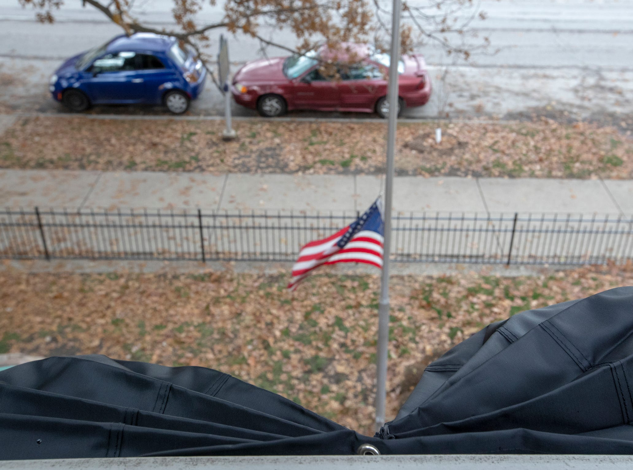 Mourning bunting and a flag at half mast at the Benjamin Harrison Presidential Site, Indianapolis, Sunday, Dec. 2, 2018. This display on the railings, and a half-mast flag, pay respects to George H. W. Bush, the 41st President, who died on Friday evening in Houston.