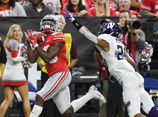 Ohio State Buckeyes receiver Terry McLaurin (83) pulls in a touchdown pass in the first half over Northwestern Wildcats defensive back Greg Newsome III (29) in the Big Ten conference championship game at Lucas Oil Stadium.
