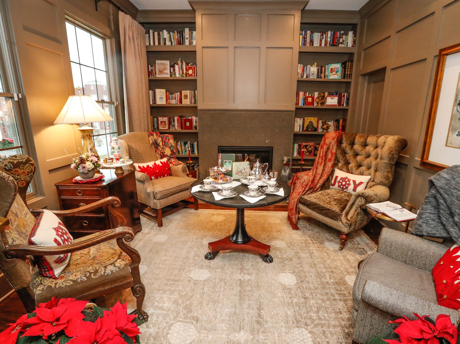 The contemporary plantation-style home belonging to Lezlie and Terry Heath features a library decked out for Christmas during the Carmel Clay Historical Society Holiday Home Tour in Carmel Ind. on Saturday, Dec.1, 2018. The couple's son, Craig Heath, helped to design the home.