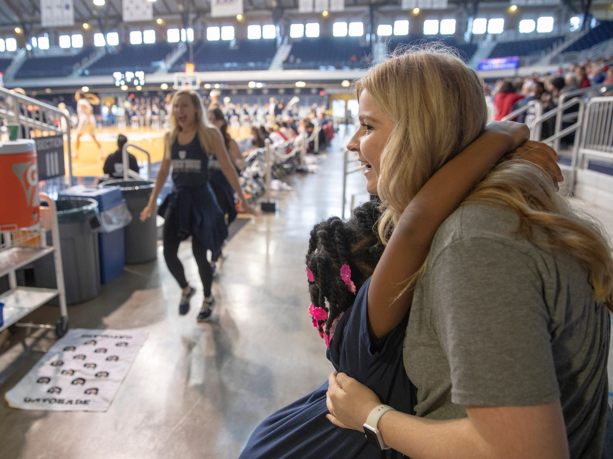 Angel Battles, 8, gives a hug to her teacher Abigail Christianson, her teacher at a special halftime performance during the Butler women's basketball game at Hinkle Fieldhouse, Indianapolis, Sunday, Dec. 2, 2018. Butler cheer and dance groups paired up with physical therapy students from Indiana University to teach young people with special needs a routine in preparation for a special performance during the afternoon's halftime show.
