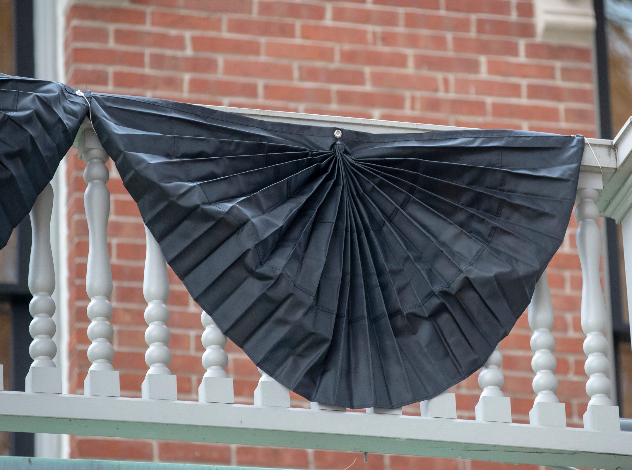 Mourning bunting at the Benjamin Harrison Presidential Site, Indianapolis, Sunday, Dec. 2, 2018. This display on the railings, and a half-mast flag, pay respects to George H. W. Bush, the 41st President, who died on Friday evening in Houston.