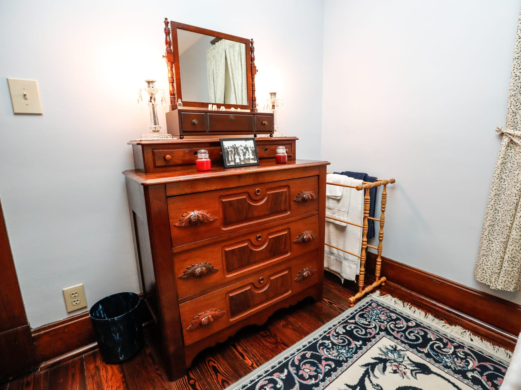 A Civil War era chest of drawers passed down through homeowner Ruth Schwartz's family decorates the 1903 home belonging to Ruth and Russell Schwartz, during the Carmel Clay Historical Society Holiday Home Tour in Carmel Ind. on Saturday, Dec.1, 2018.