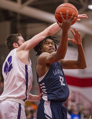 La Lumiere High School senior Keion Brooks, Jr. (12) is fouled by Brownsburg High School senior Ryan Wiggins (42) as he puts up a shot during the second half of action. Danville High School hosted IHSAA varsity basketball action between La Lumiere and Brownsburg high schools, Saturday, Dec. 1, 2018. La Lumiere won 72-63.